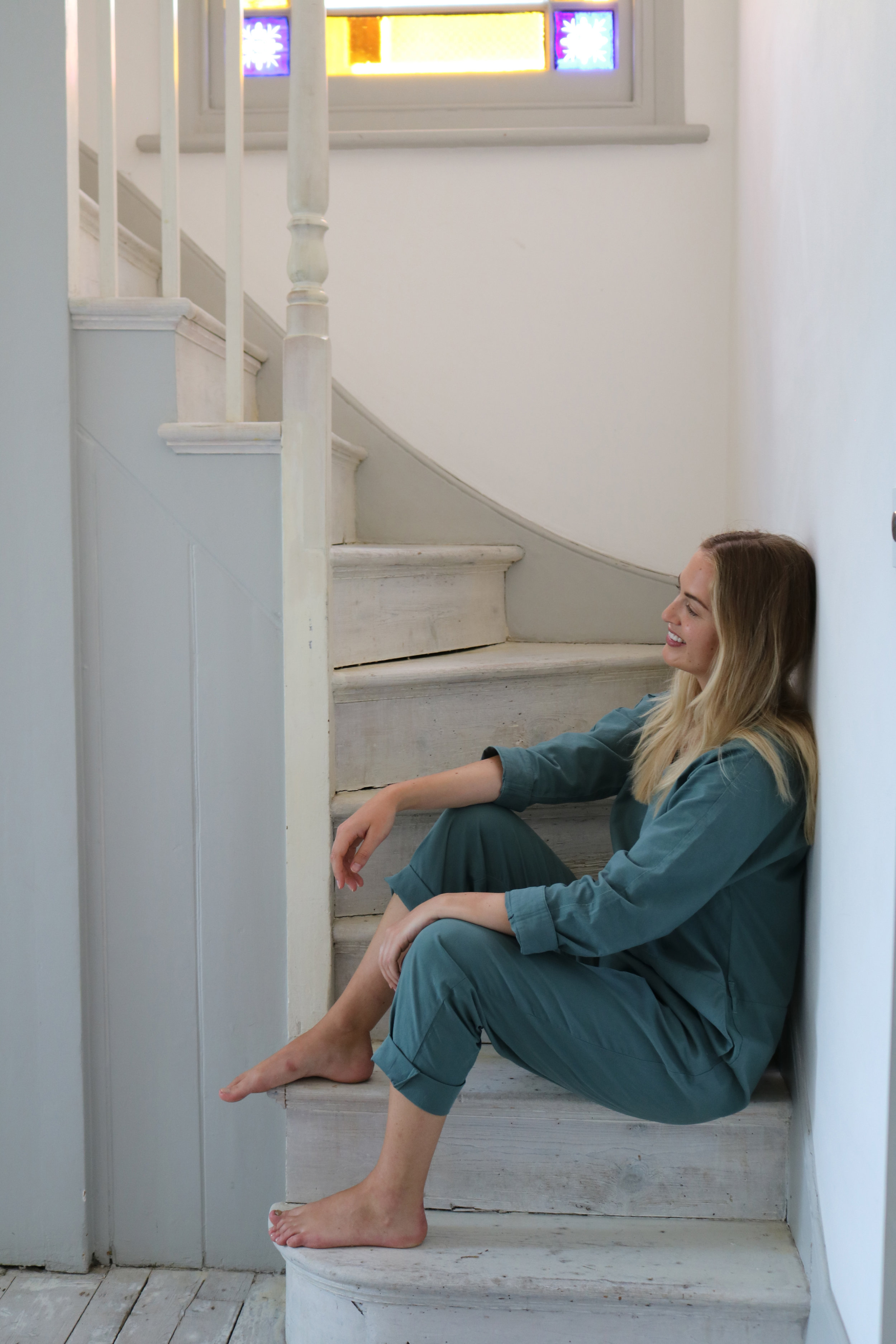Blonde girl sitting on stairs | London Lifestyle Workshop | Photograph