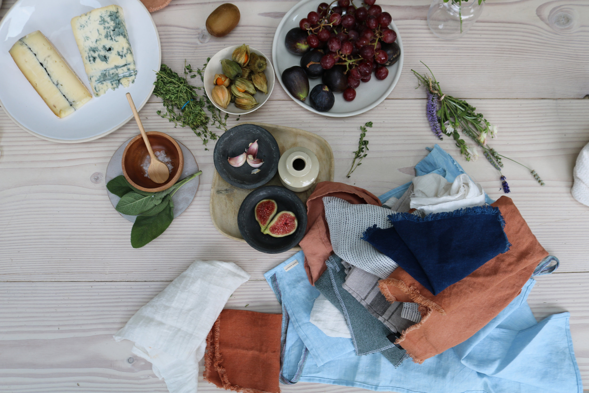 Flat lay with coloured fabrics and cheese and grapes | London Lifestyle Photoshoot | Creative Direction