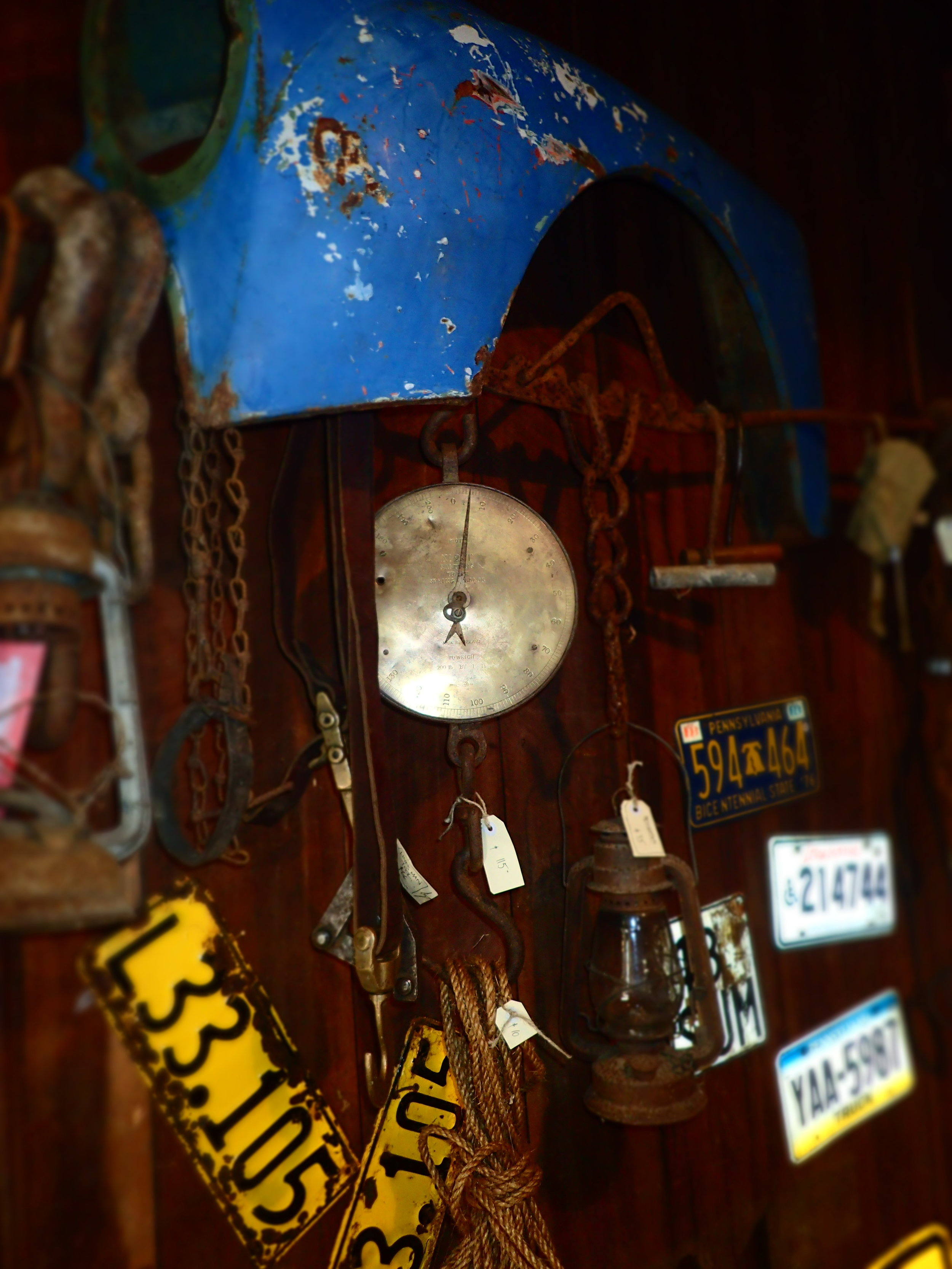 Mancave essentials : NZ & american numberplates, old salter scales to weigh your hunting trophy, kerosene lantern,rusty chains.