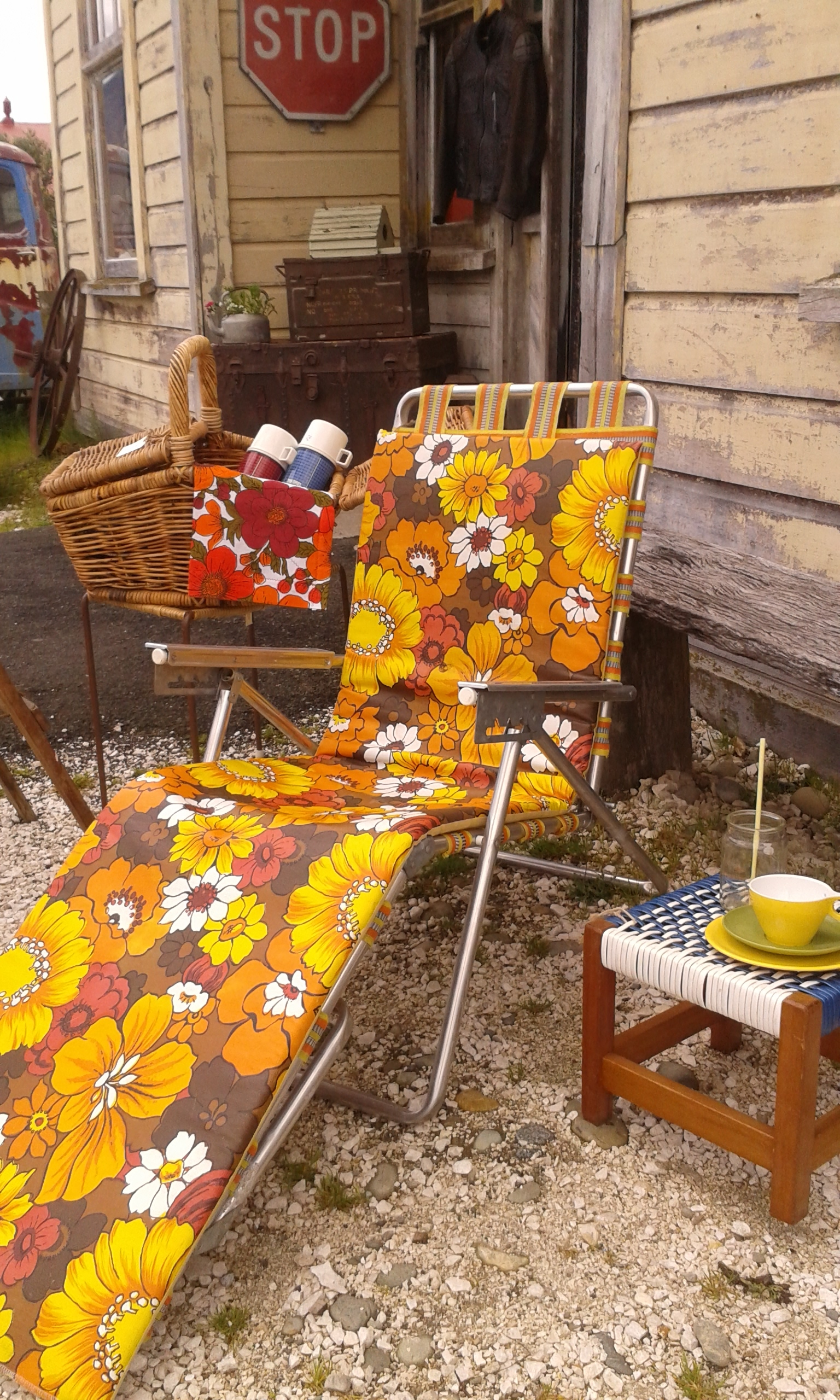 Relaxing in the sun feels great with the right Retro sunlounger and Duraware picknick ware goodies. Rad old chests in the background.