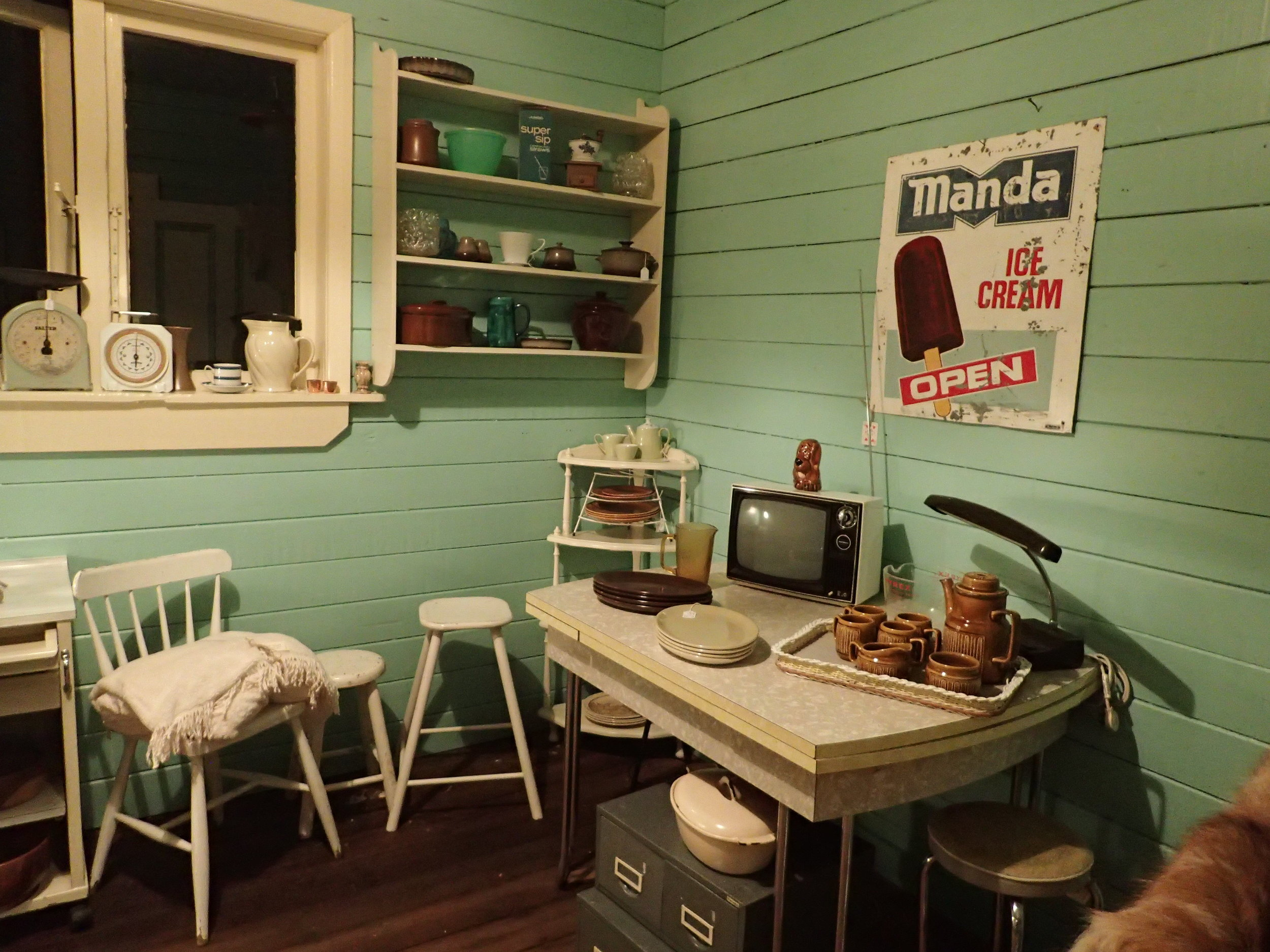 Formica and Crown Lynn, original Manda Icecream advertising sign and kitchenalia  like the vintage scales and antique Temuka ceramic but electric(!) jug from the early 1900.