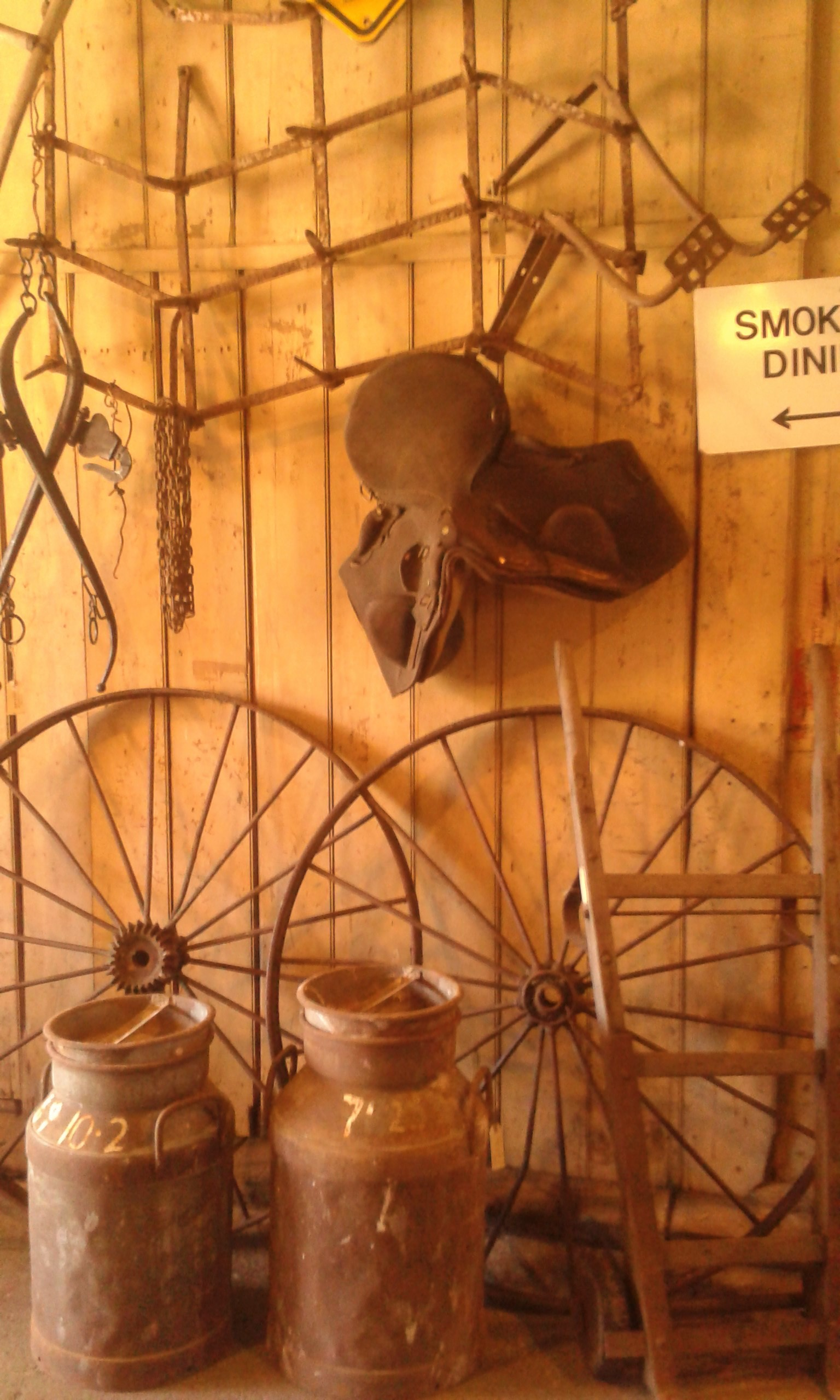 Countryfinds : C.1940's cream cans, steel waggon wheels, horse haynes , rustic chains and a cool sack barrow.