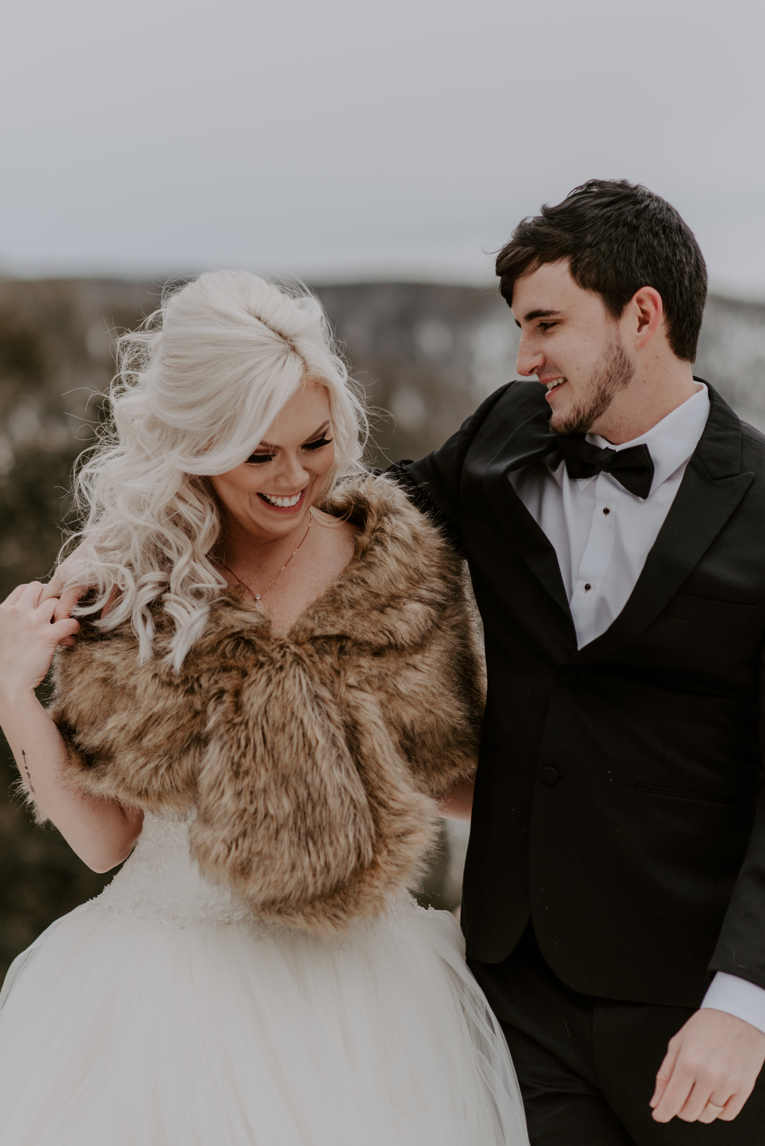 Photos of bride & groom at a winter elopement at Sapphire Point taken by a Colorado wedding photographer.