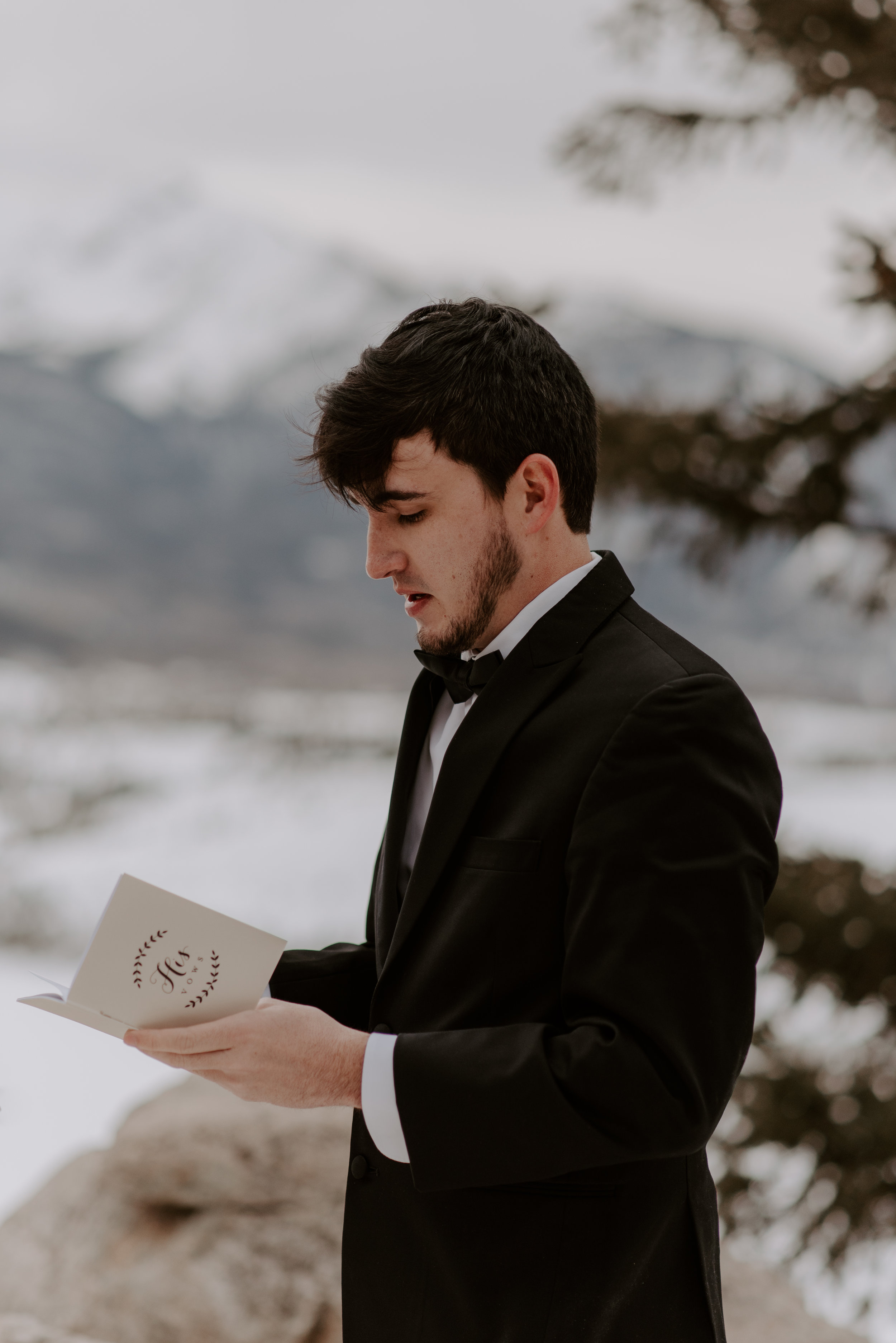 Groom reading his vows at a winter Sapphire Point elopement in Colorado.