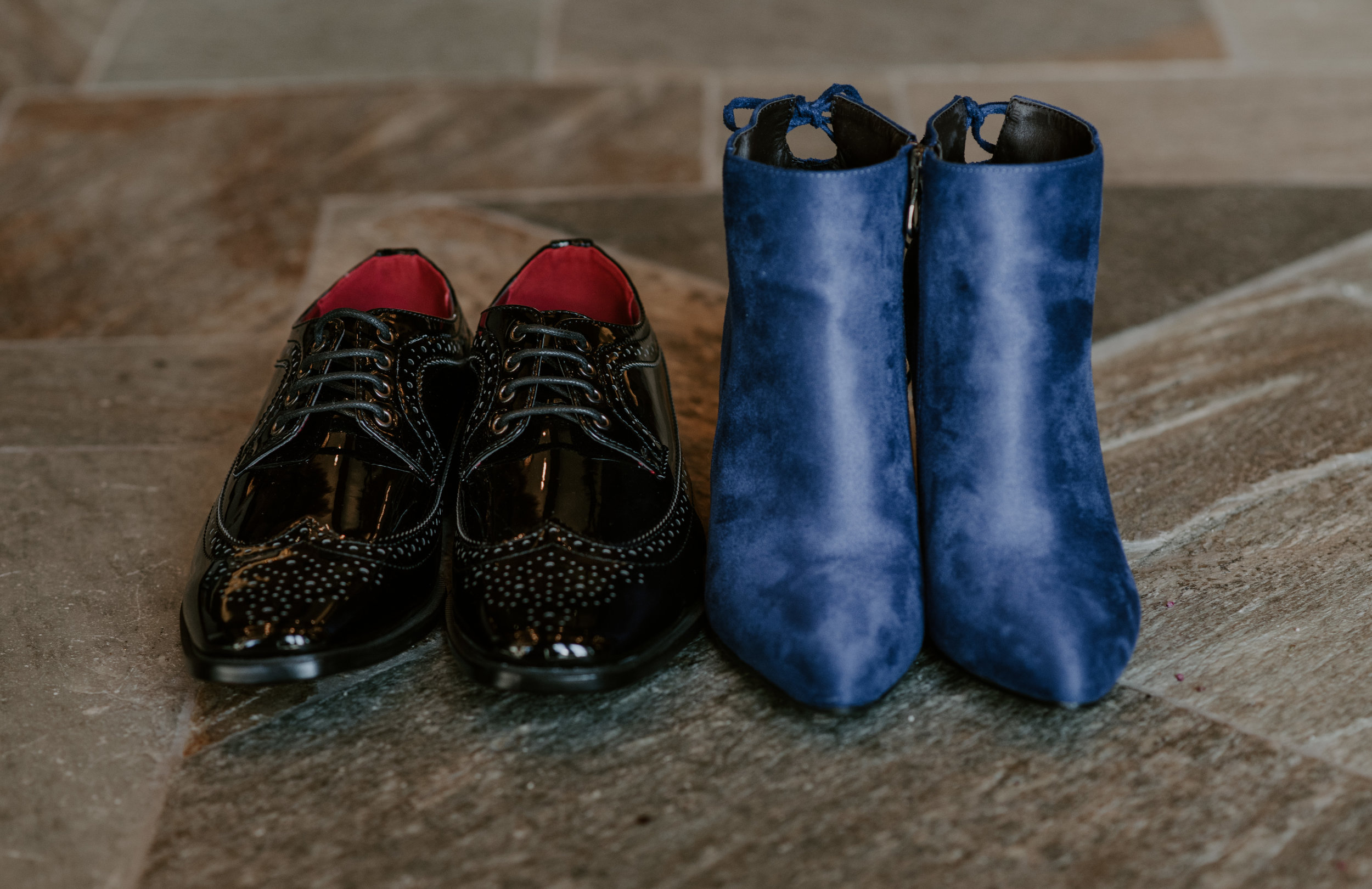 Beautiful detail shot of the bride and groom's shoes taken by a Colorado wedding and elopement photographer.