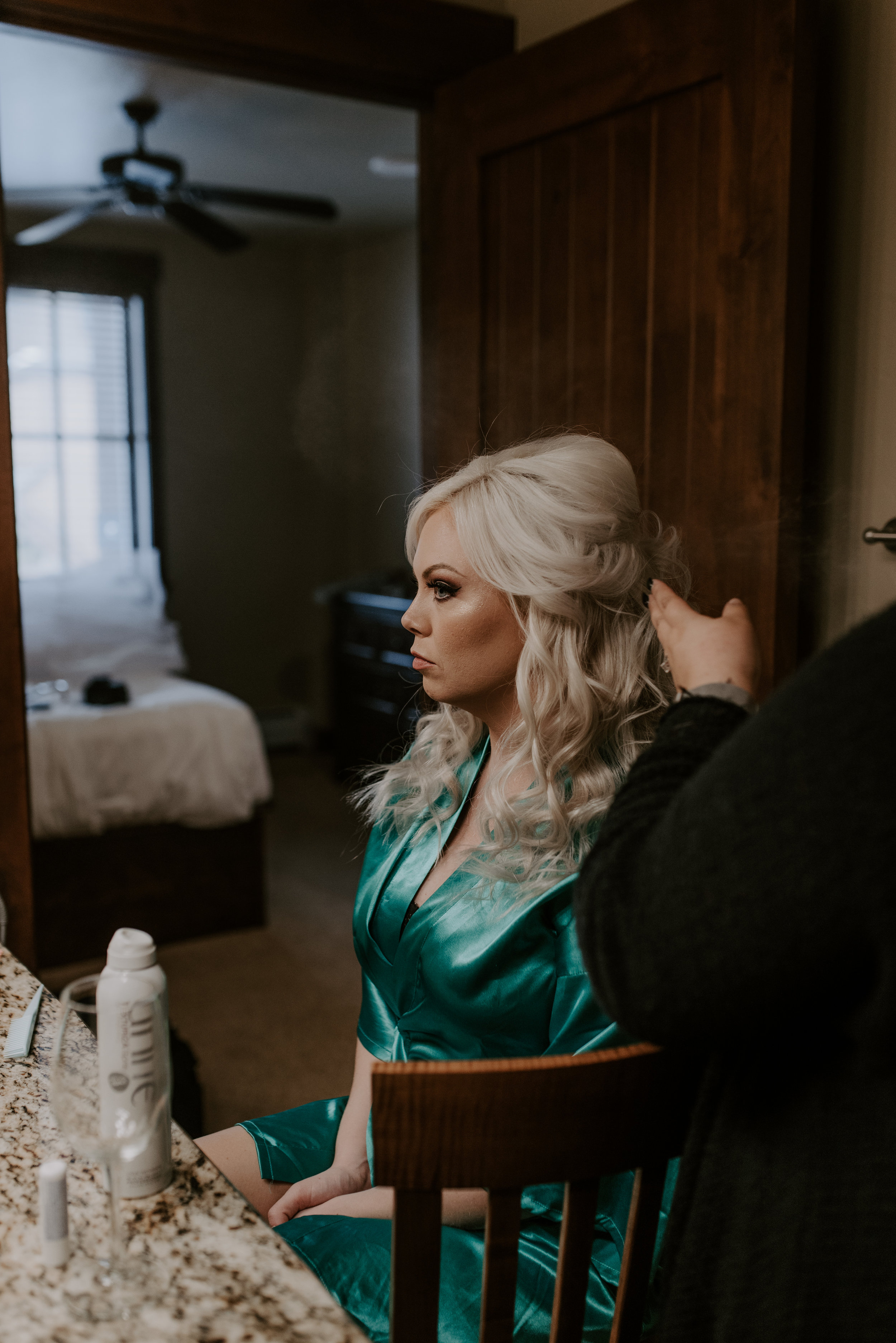 Bride getting ready before her Colorado elopement at Sapphire Point in Breckenridge. Colorado elopement and wedding photographer.