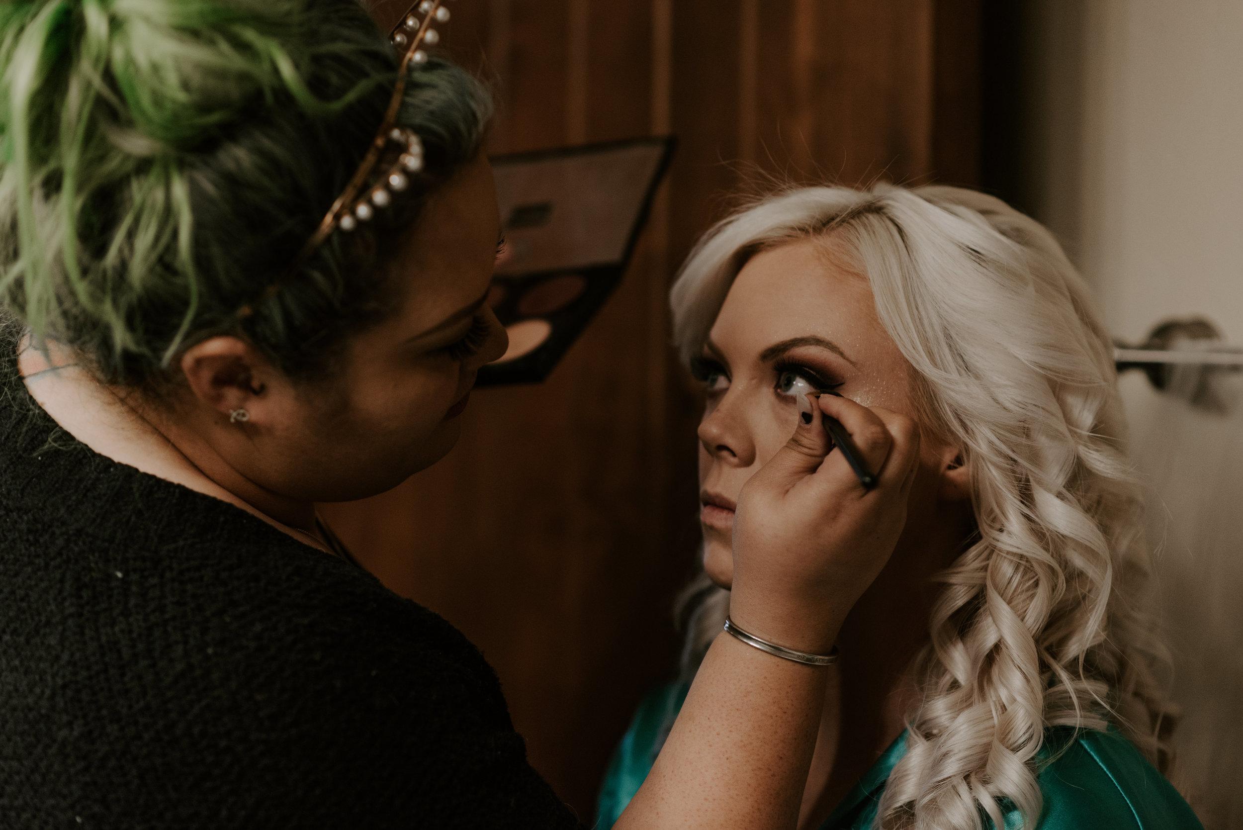Bridge getting her makeup done before her wedding in Colorado.