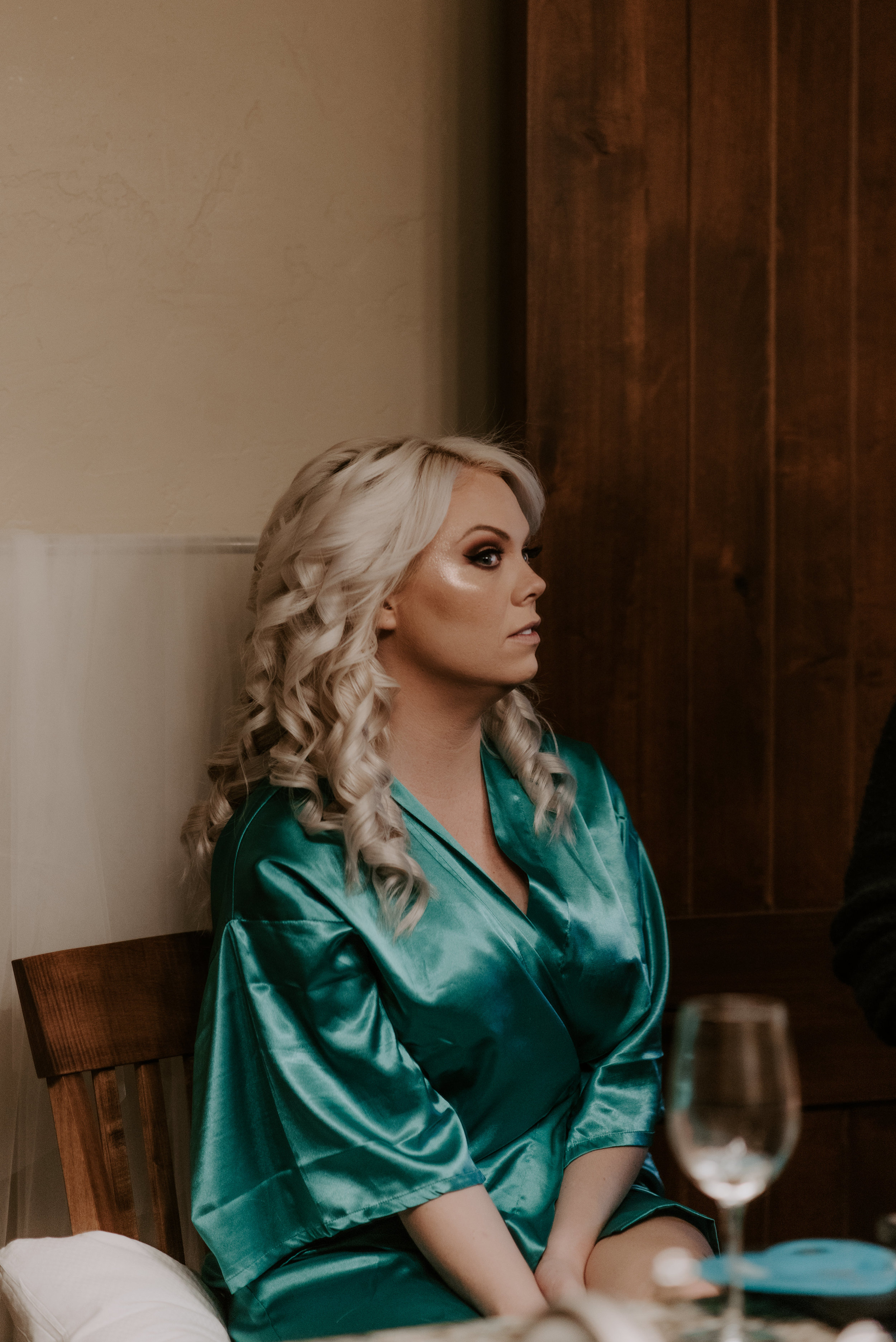 Colorado elopement photographer. Bride and groom getting ready before ceremony.