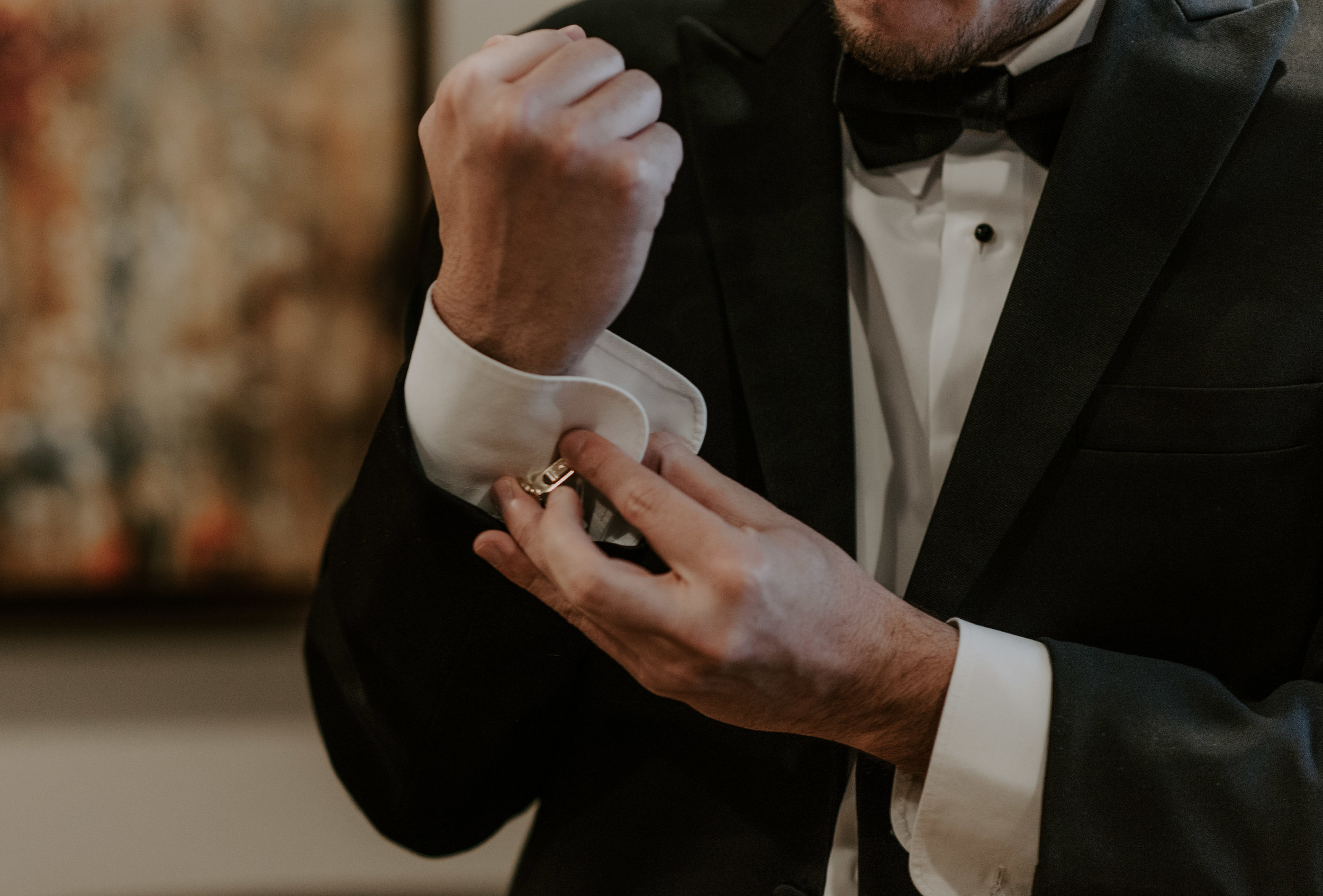 The groom getting ready before a winter elopement at Sapphire Point, taken by a Colorado adventure wedding photographer.