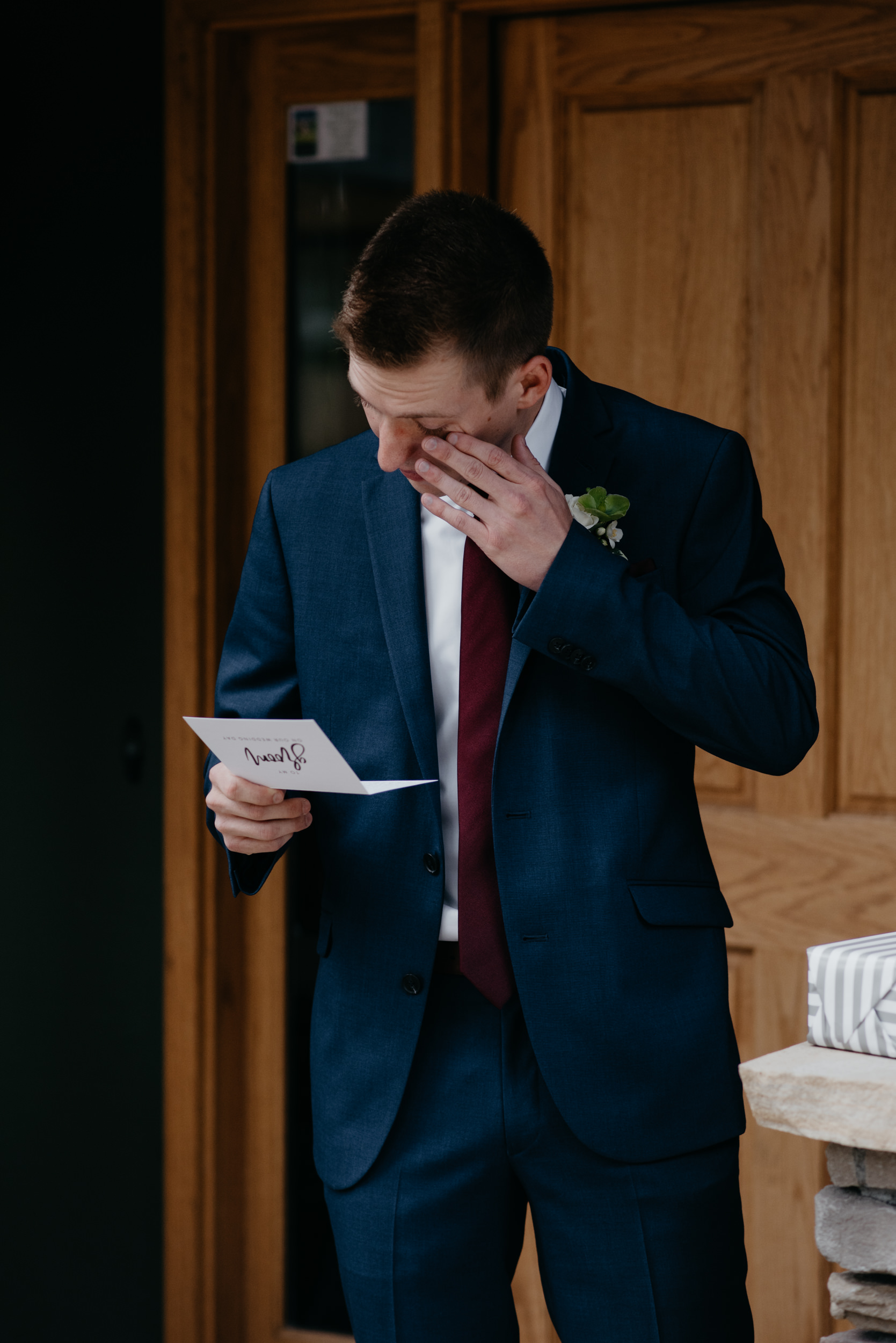 Groom opening gift. 3M Curve, Rocky Mountain National Park elopement.