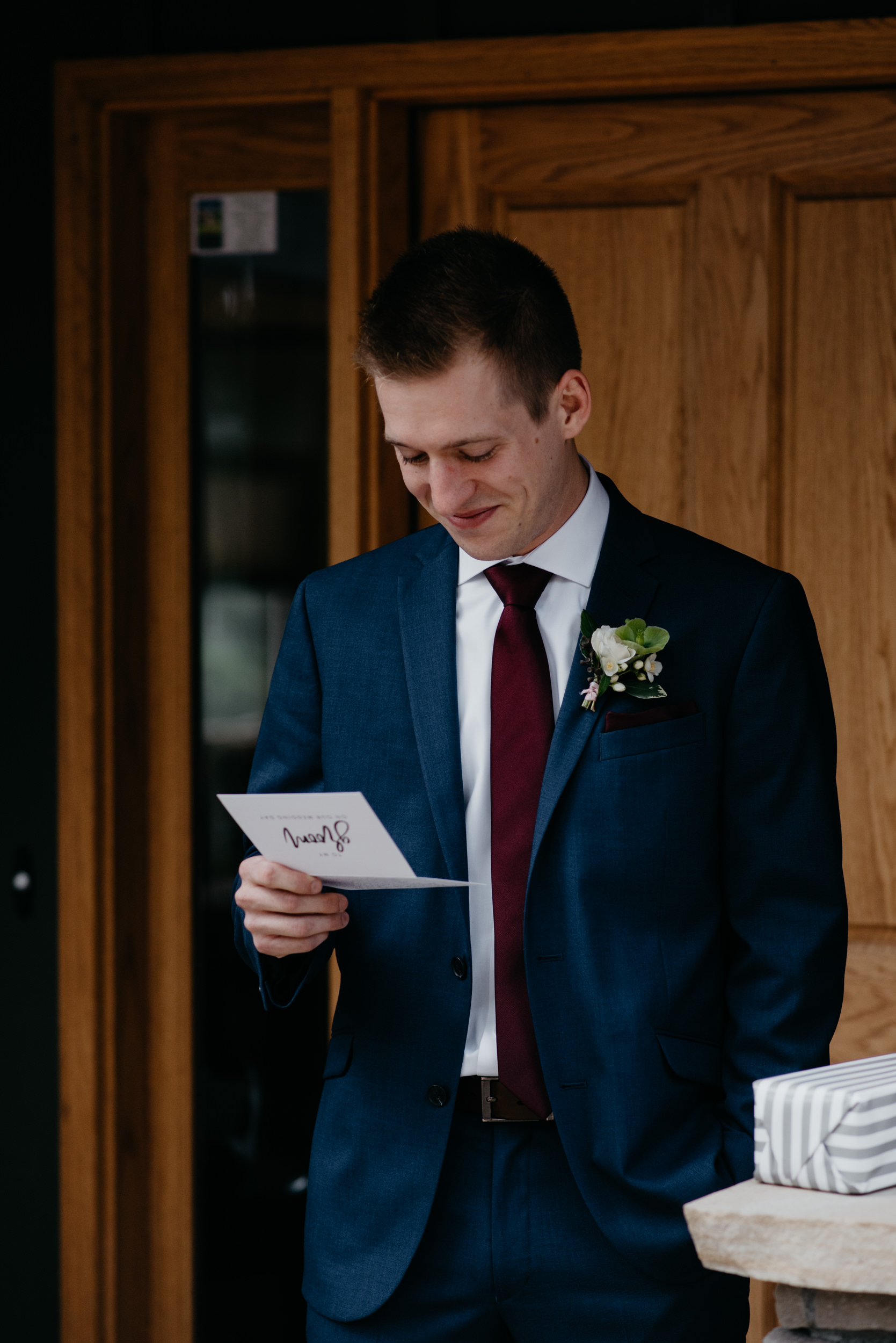 Groom opening gift from bride. 3M Curve, Rocky Mountain National Park elopement.