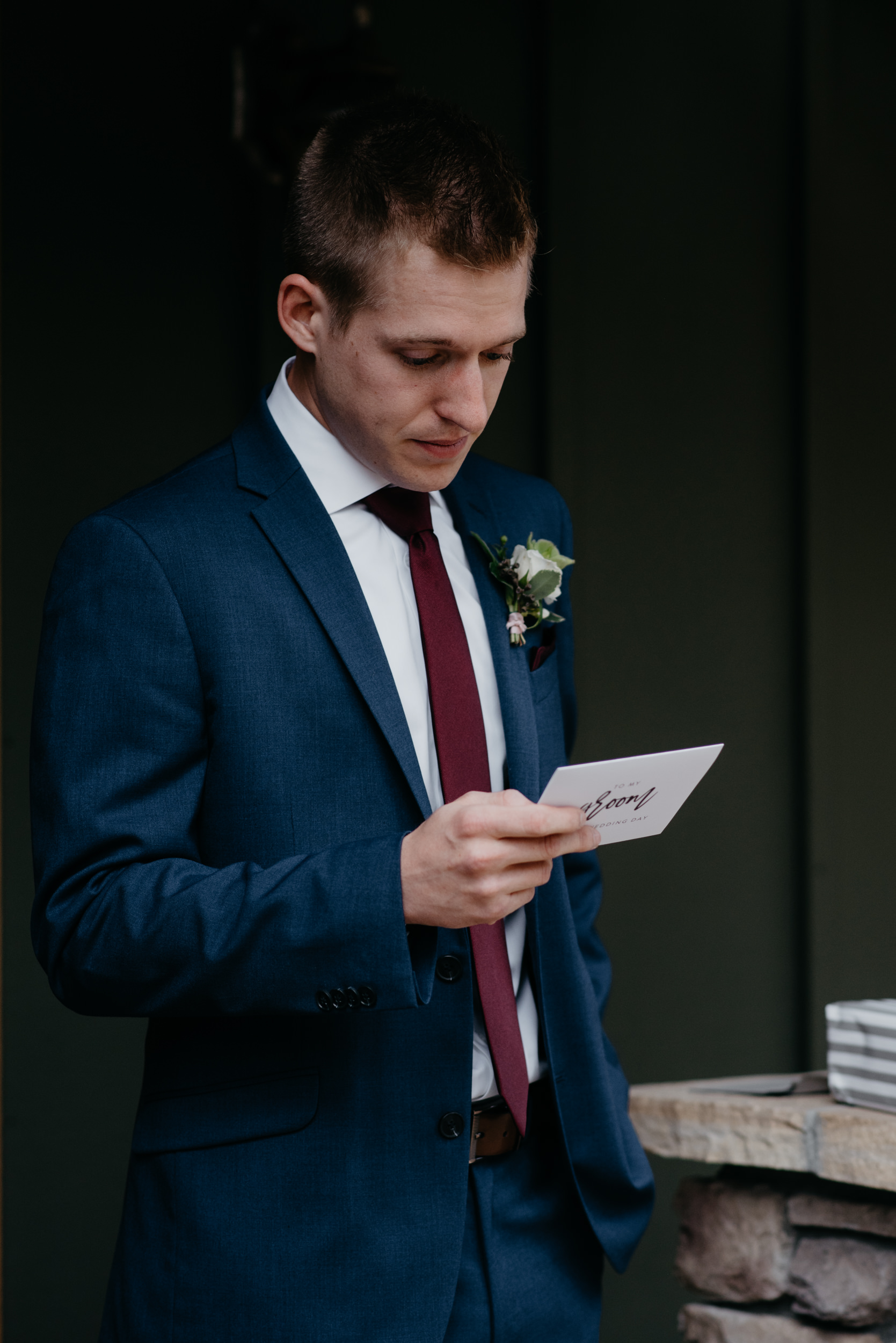 Groom opening gift. 3M Curve, Rocky Mountain National Park elopement photos. Colorado wedding photographer.