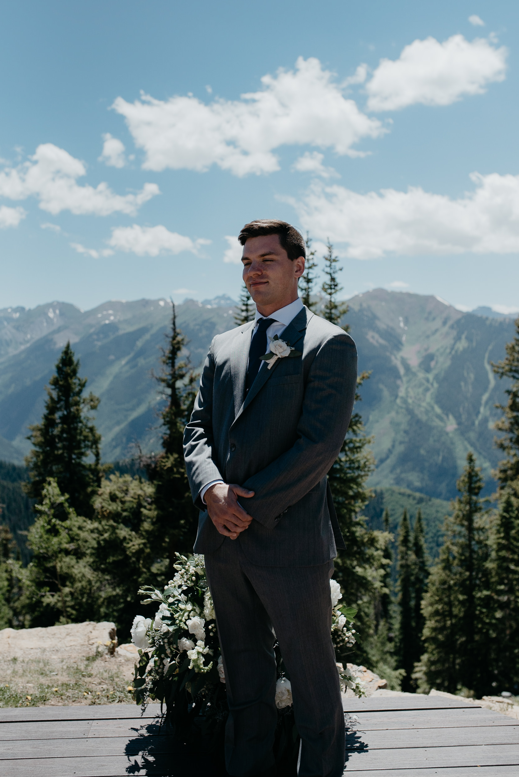 Groom at wedding ceremony in Aspen, Colorado at The Little Nell.