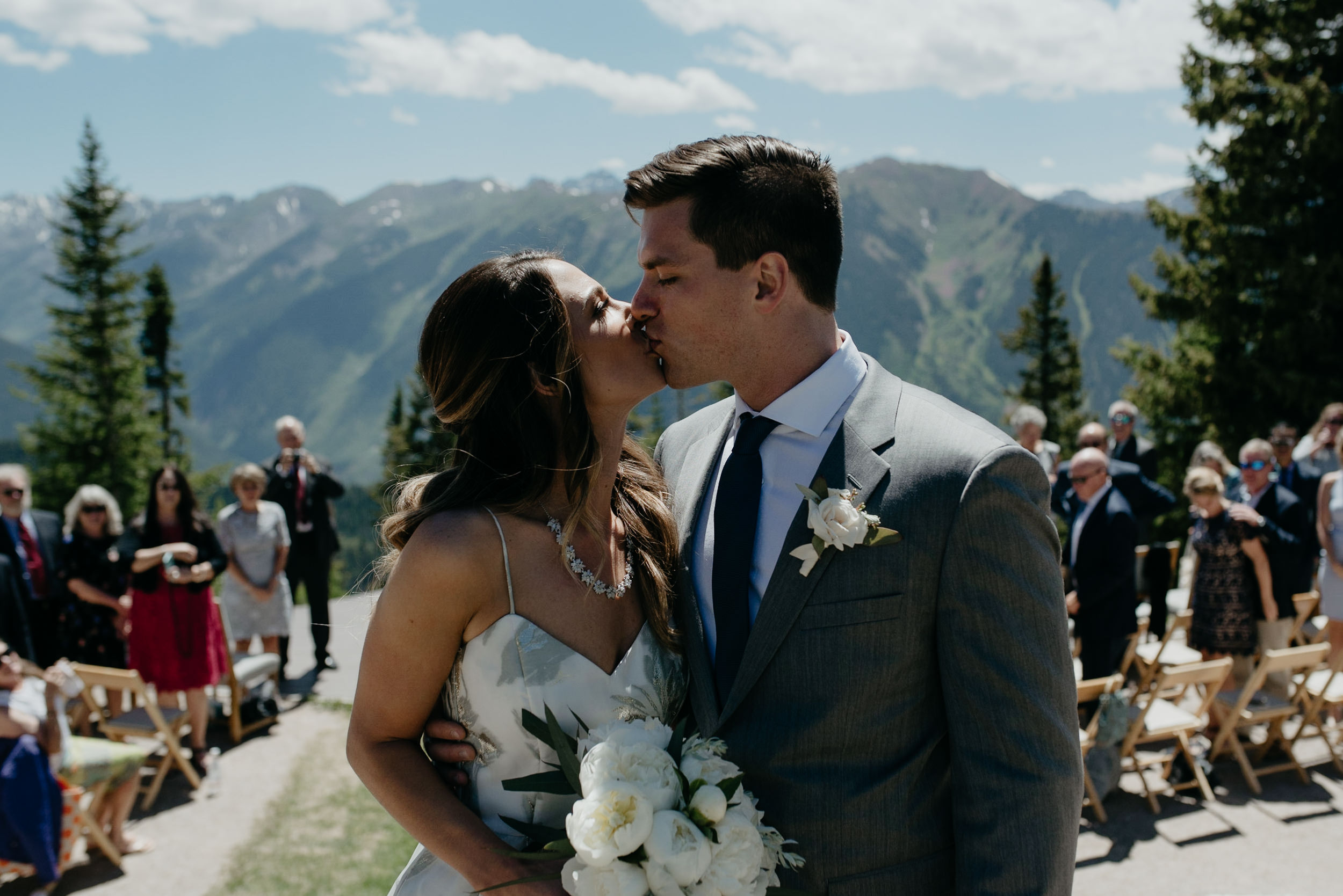 Bride and groom kiss at The Little Nell. Colorado wedding and elopement photographer.