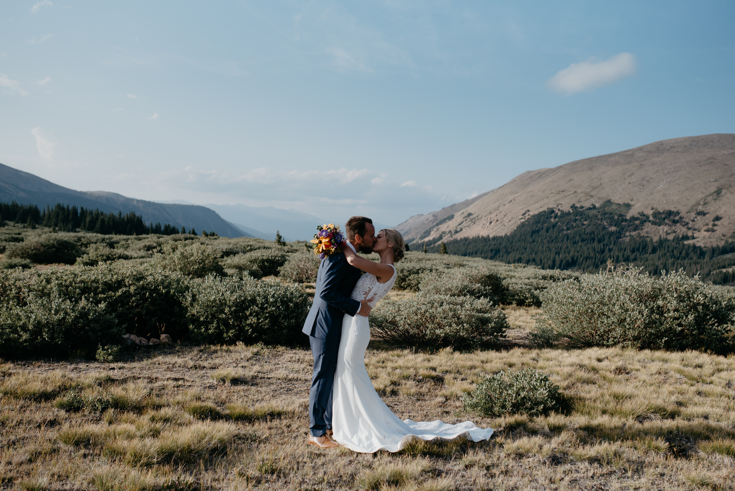 Bride and groom first kiss at Guanella Pass elopement
