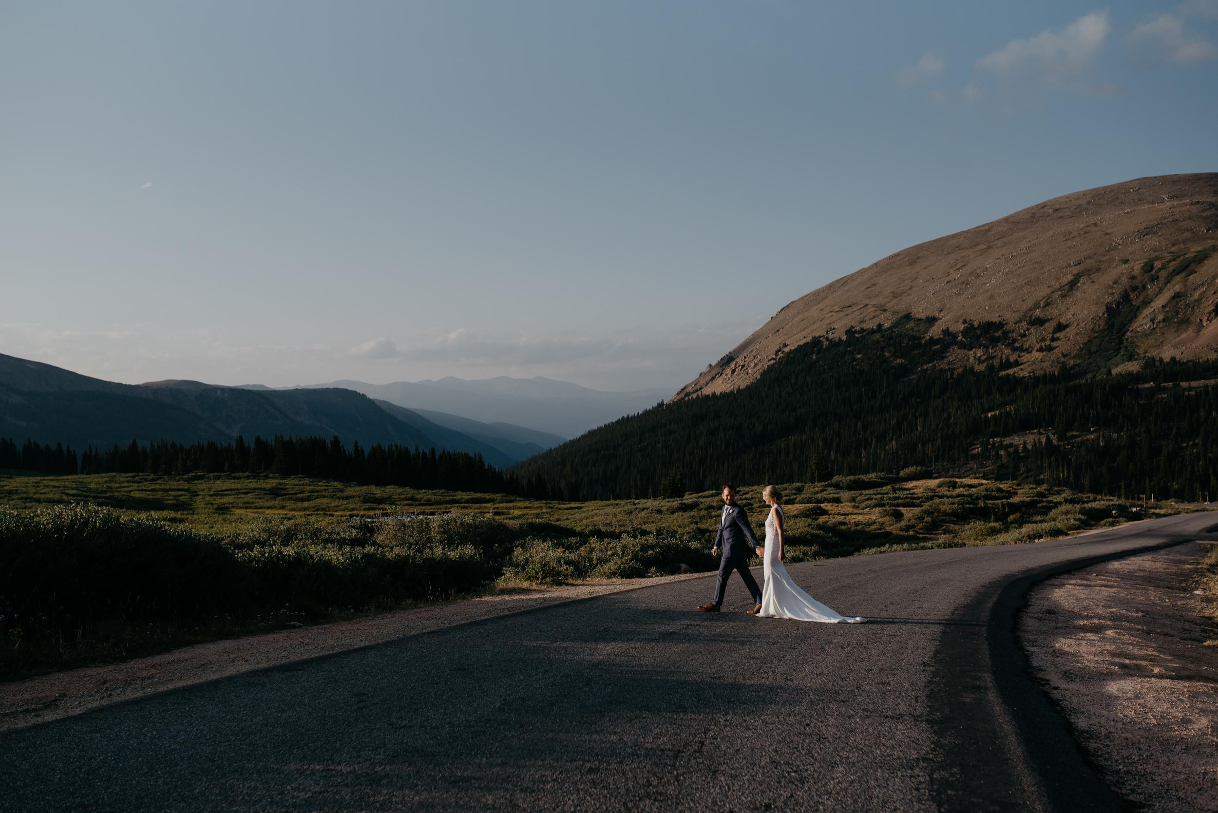 Bride and groom walking in the road