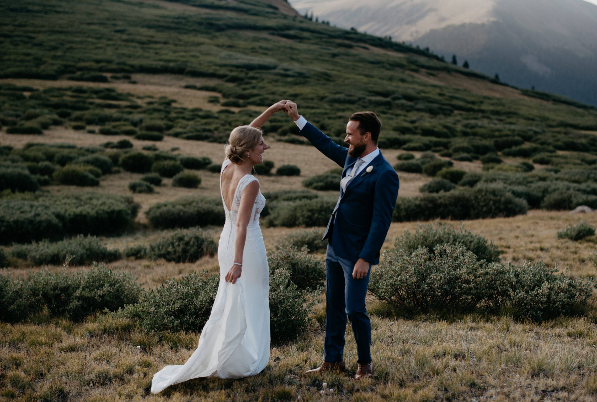 Groom spinning bride at a Georgetown, CO elopement.