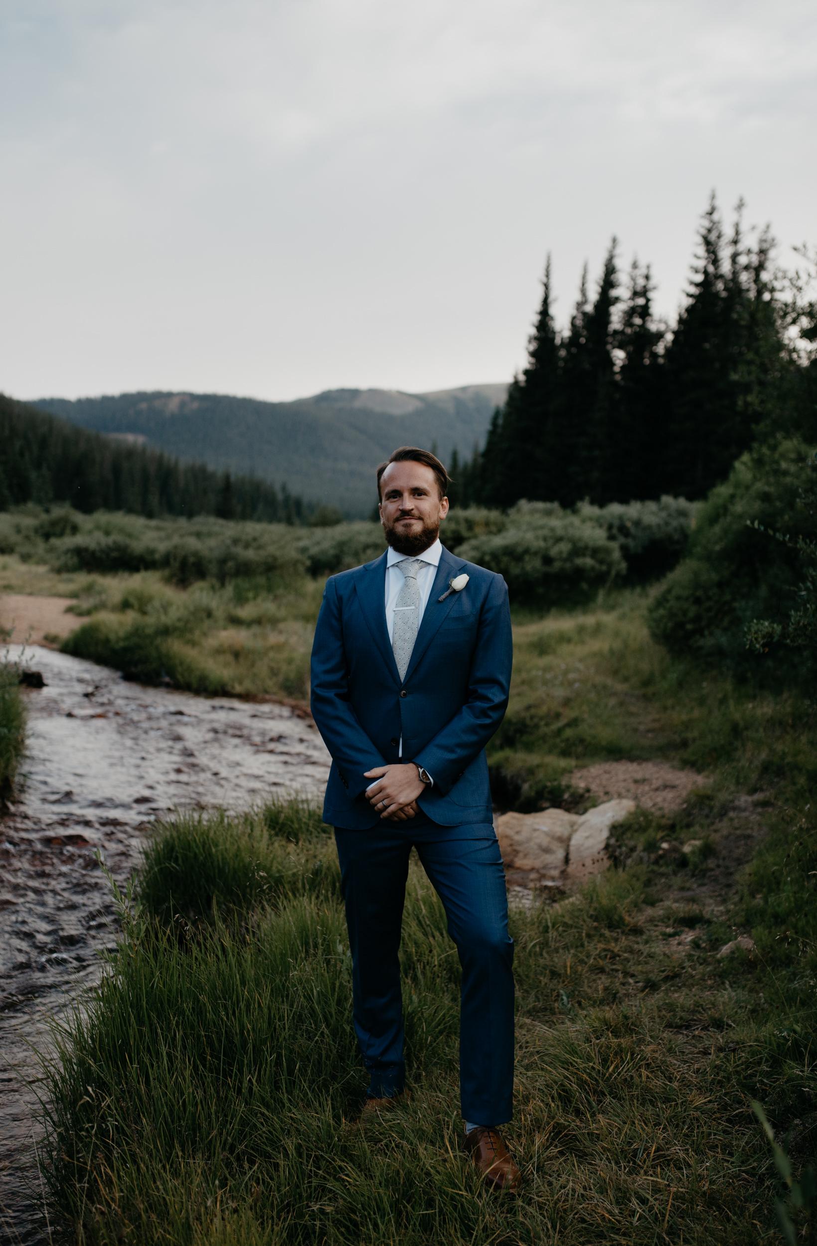 Portrait of groom by Colorado elopement photographer, Alyssa Reinhold.
