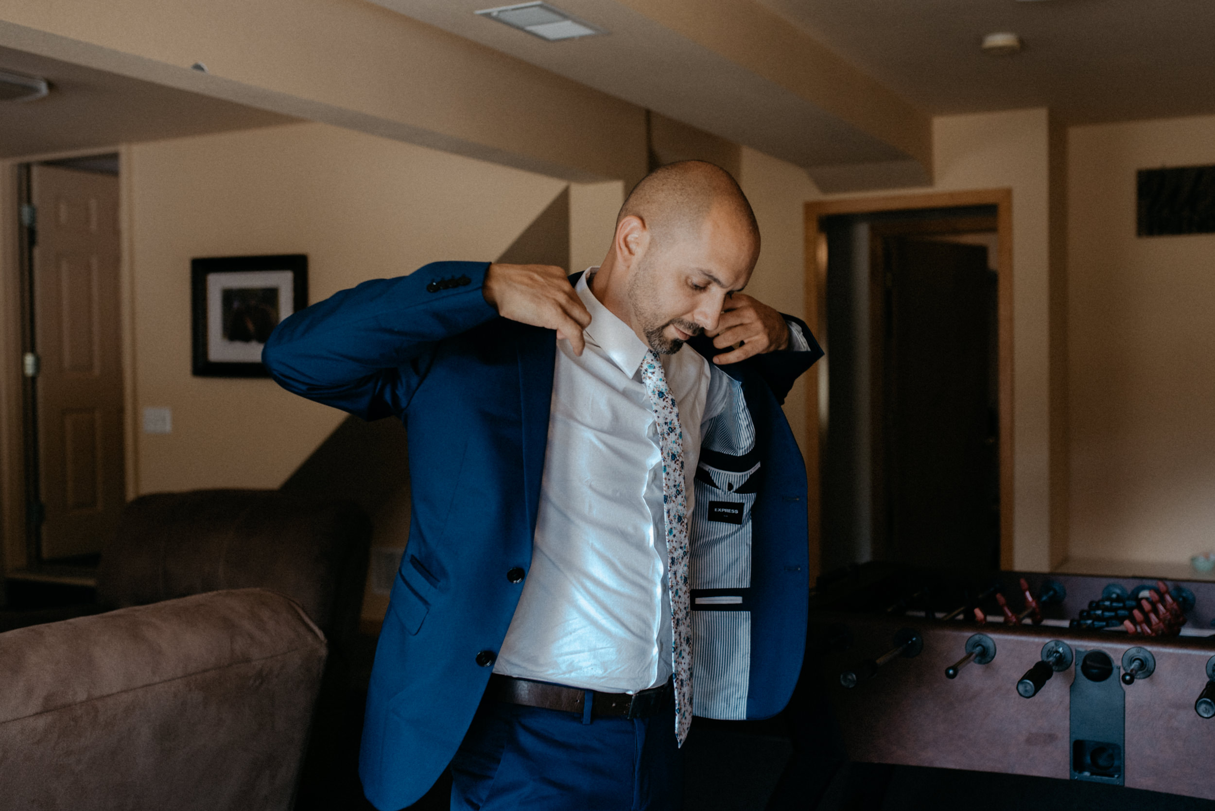 Groom getting ready. Colorado elopement and wedding photographer.