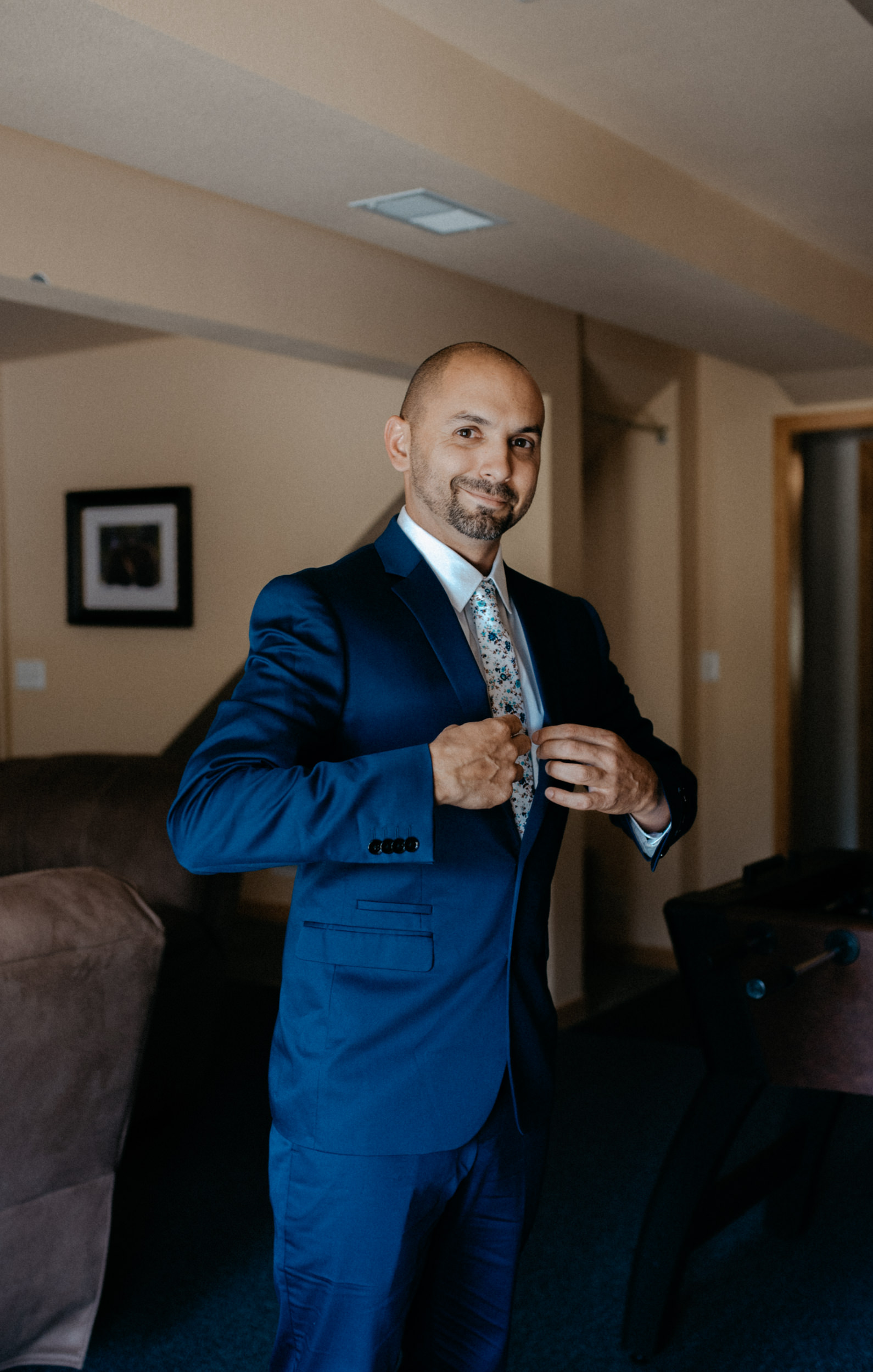 Groom getting ready before Colorado elopement. Rocky Mountain National Park wedding photographer.