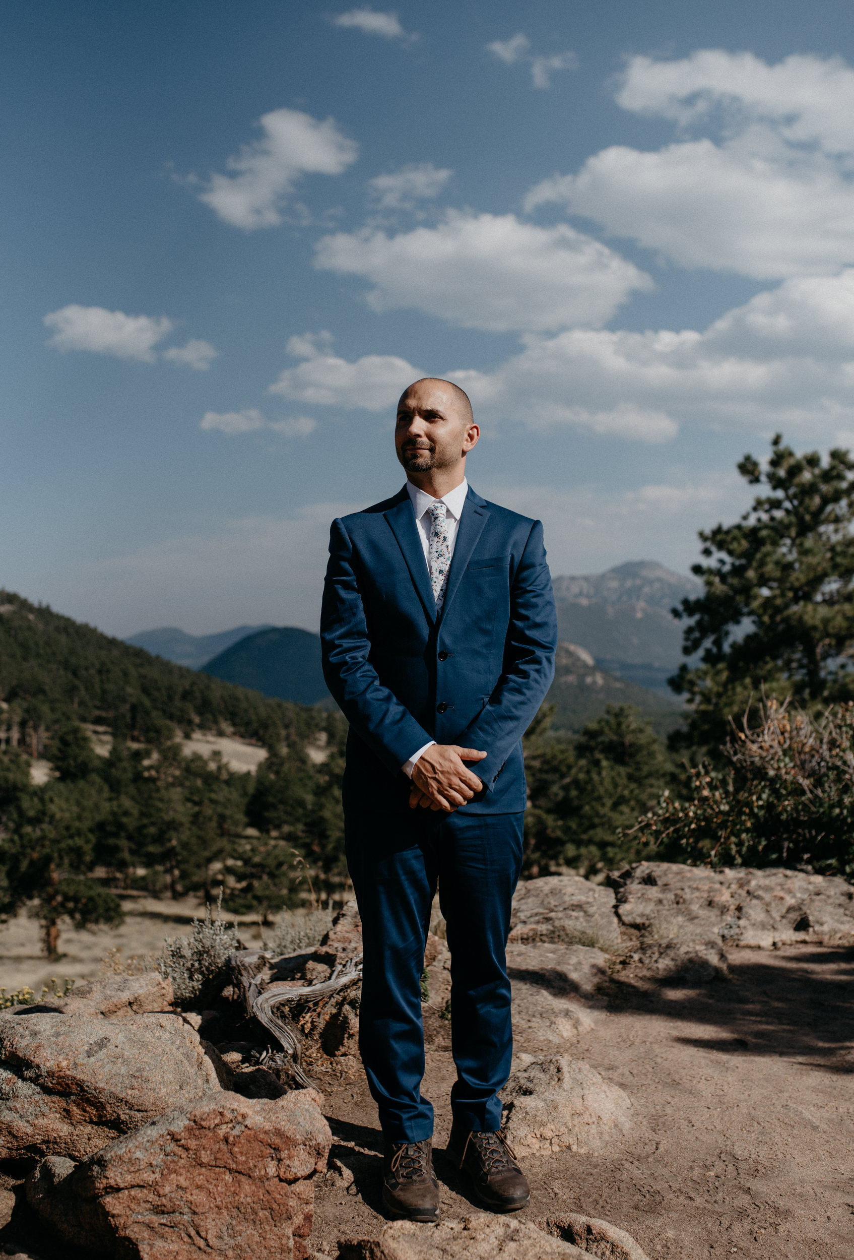Groom waiting for bride for an elopement at 3M curve. Colorado wedding and elopement photographer.