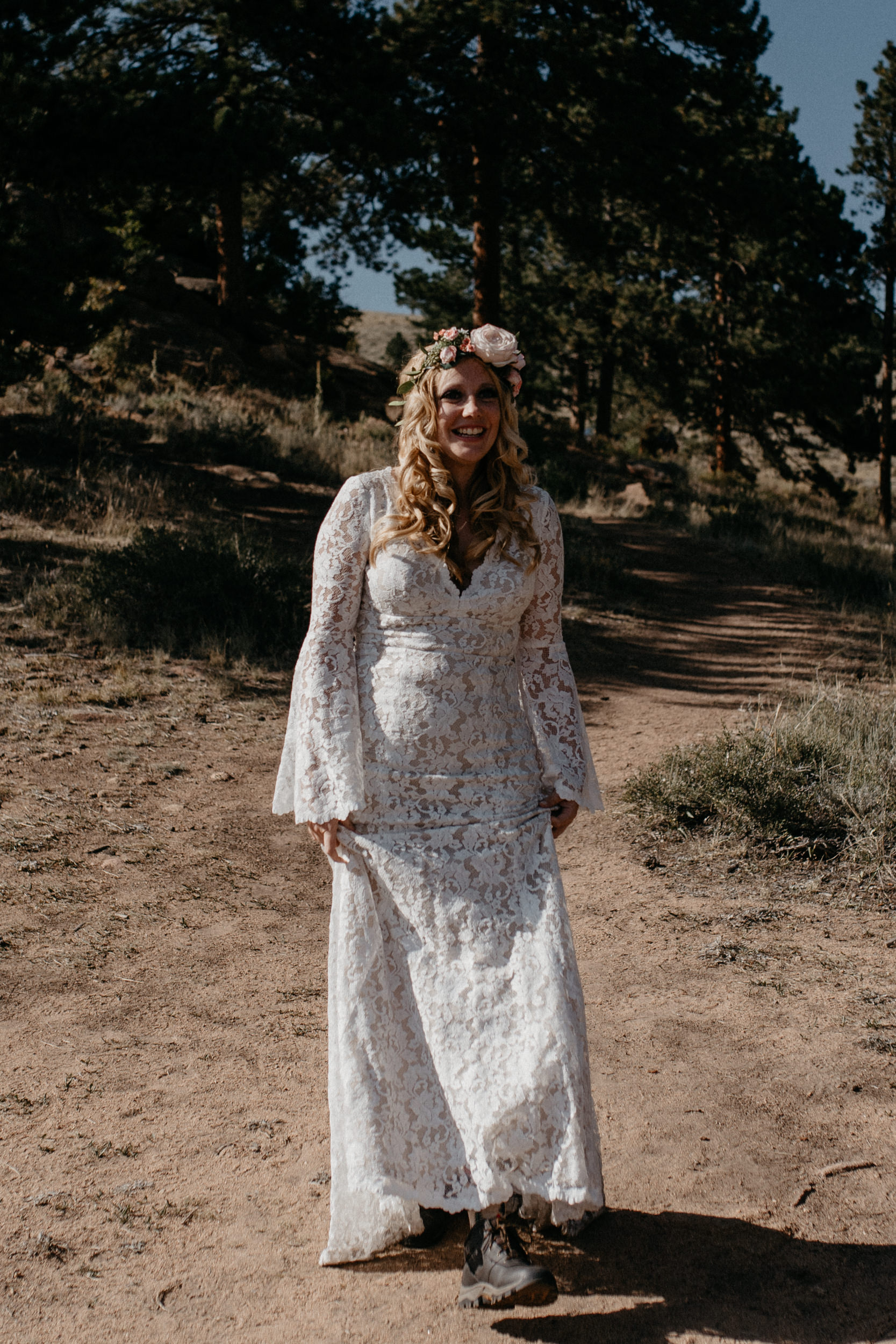 Bride walking down alter at 3M curve elopement in Rocky Mountain National Park.