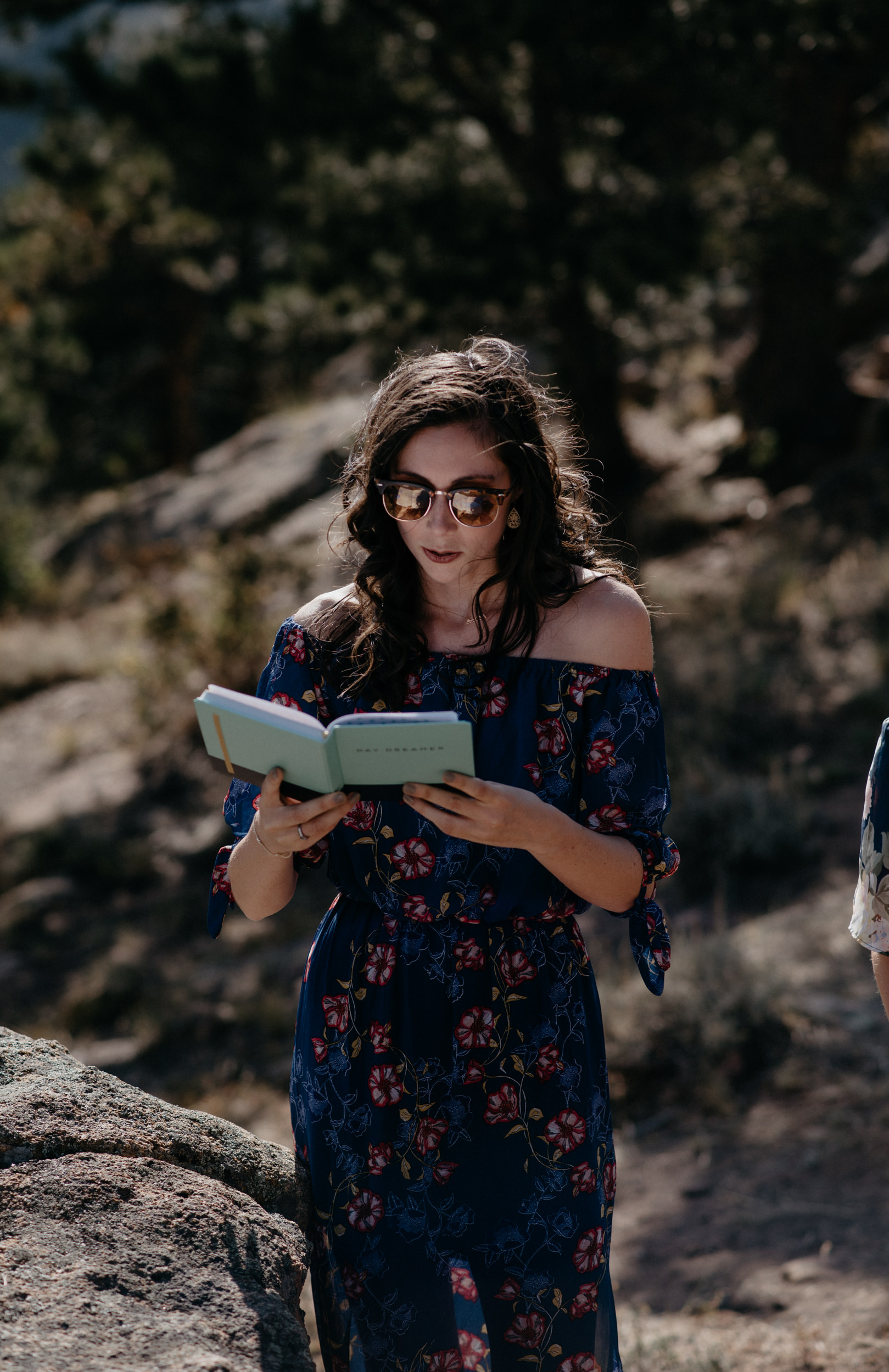 Colorado elopement and wedding photographer. 3M curve elopement. Friend reading at ceremony.