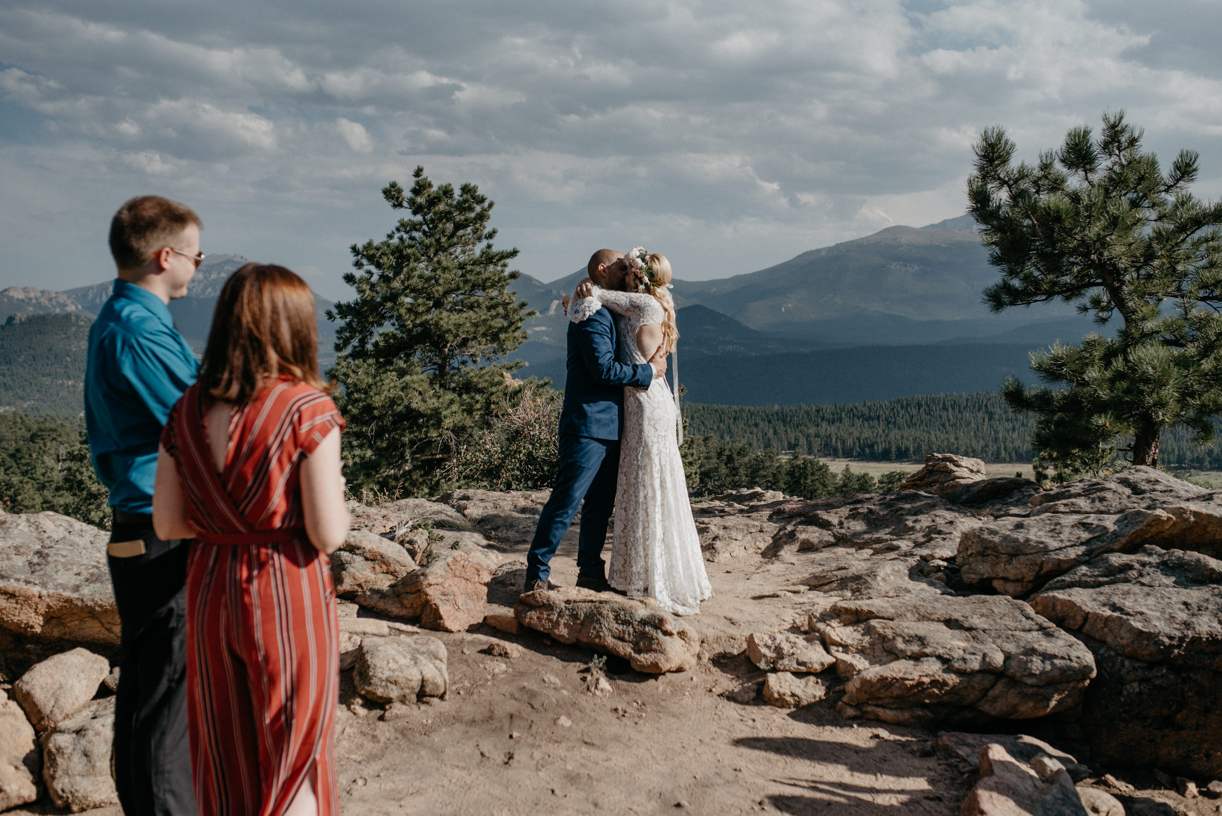 First kiss at intimate ceremony in Rocky Mountain National Park. Colorado elopement at 3M curve