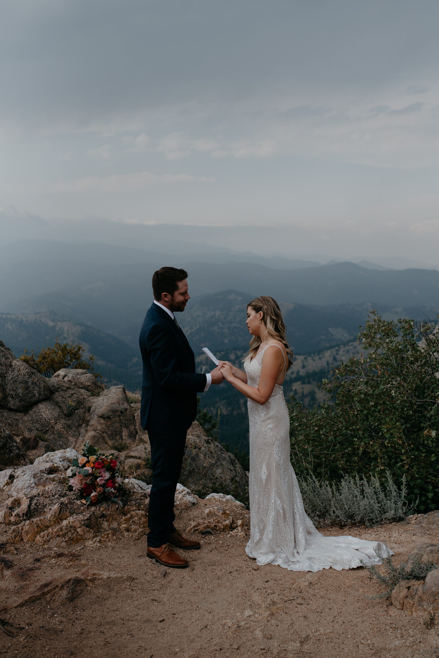 Bride and groom exchanging vows at a mountaintop elopement in Boulder, Colorado. Denver wedding and elopement photographer for adventurous couples.