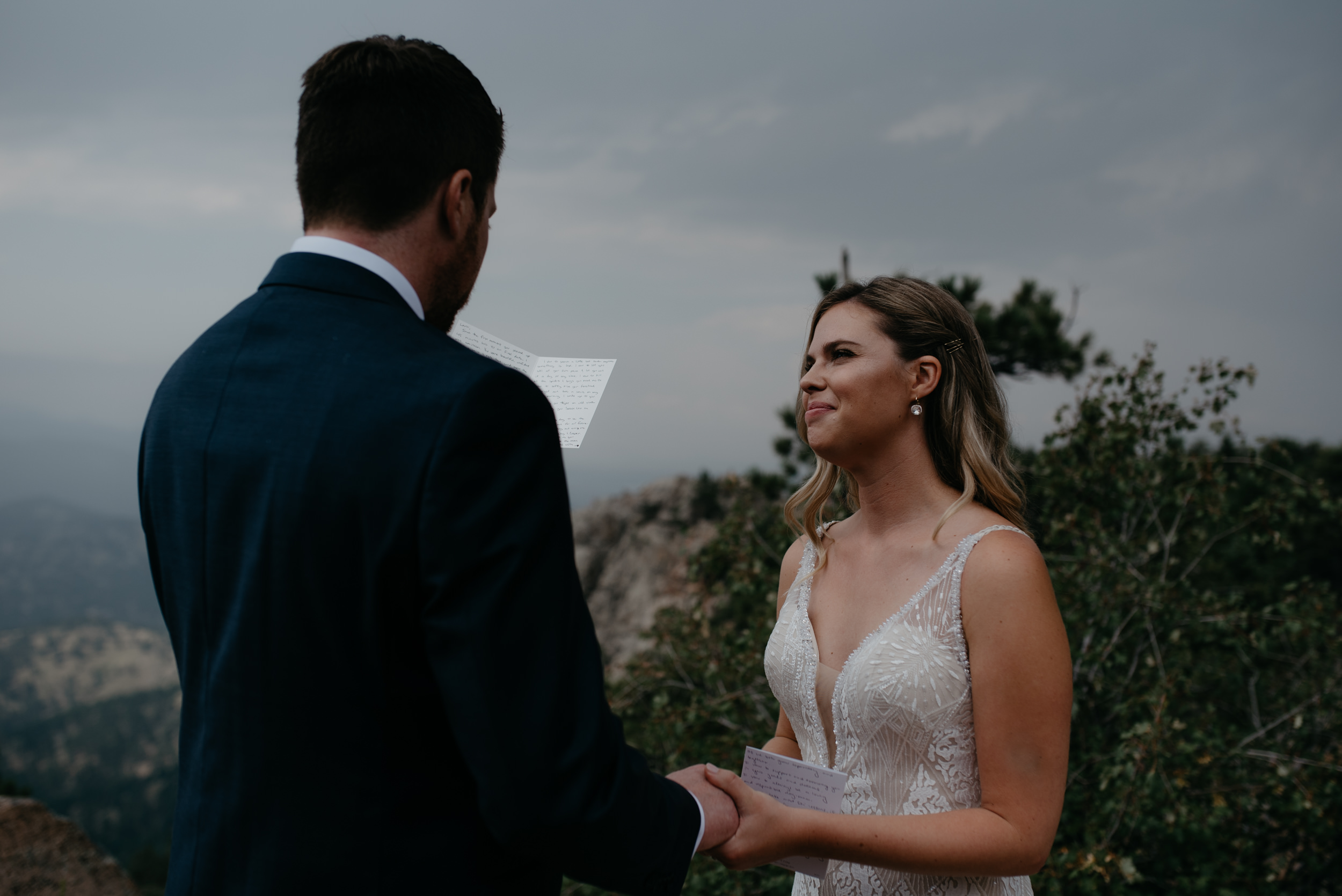 Colorado elopement and wedding photographer. Bride and groom exchanging vows in Boulder, Colorado at Lost Gulch.