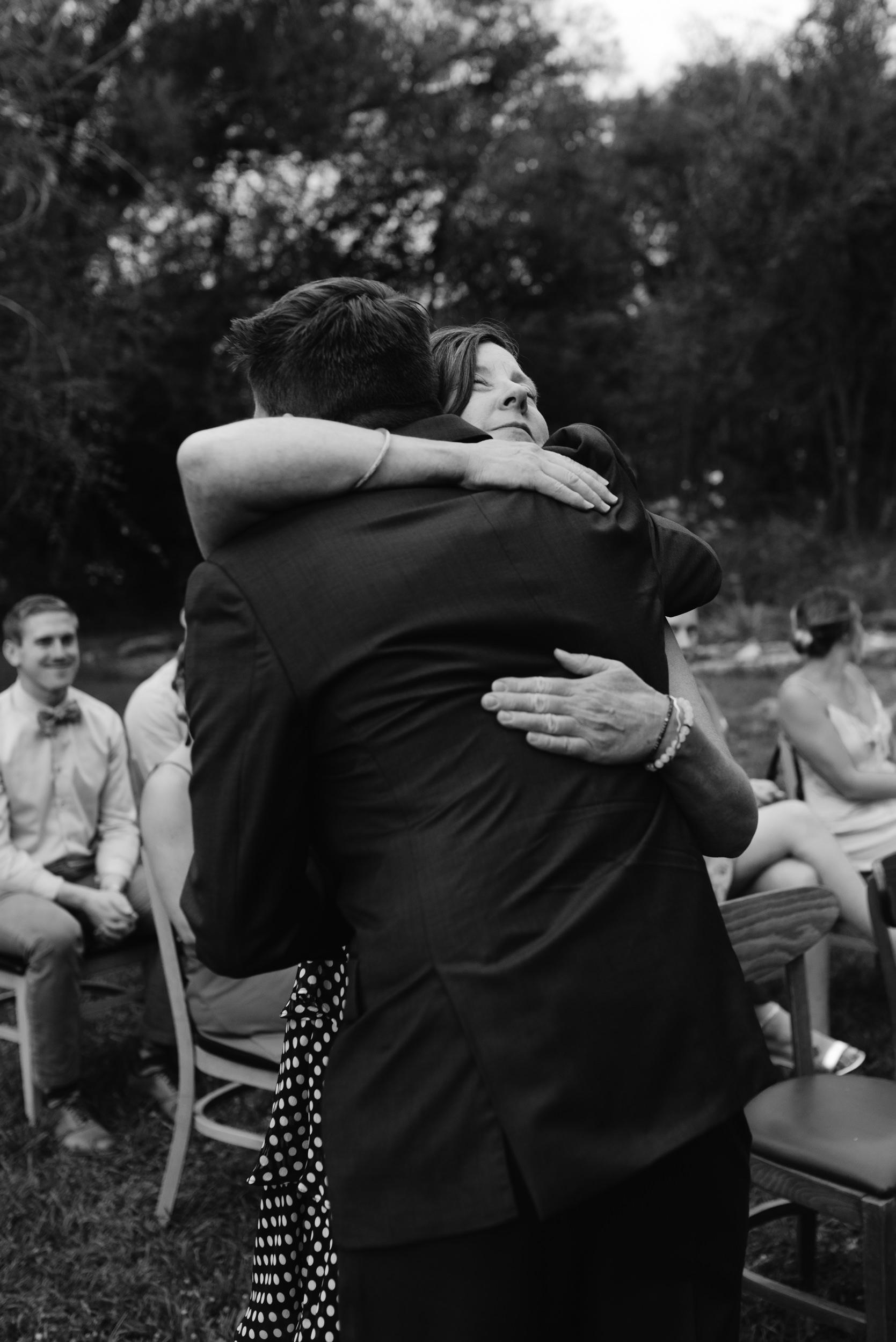 Groom and mom at Boulder wedding ceremony. Three Leaf Farm wedding. Colorado wedding and elopement photographer.