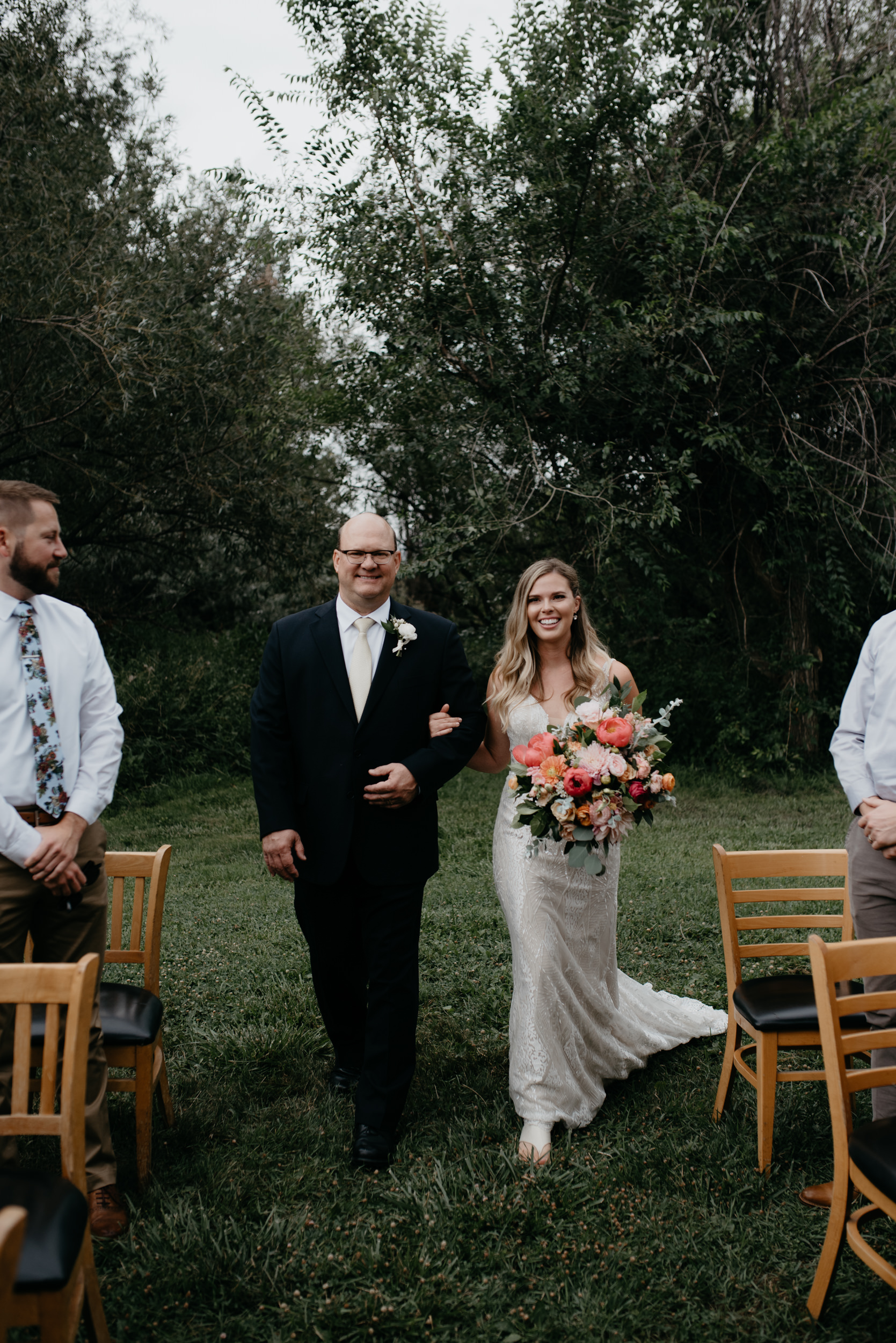 Bride and dad walking down the isle at Boulder, Colorado wedding at Three Leaf Farm. Colorado elopement photographer.
