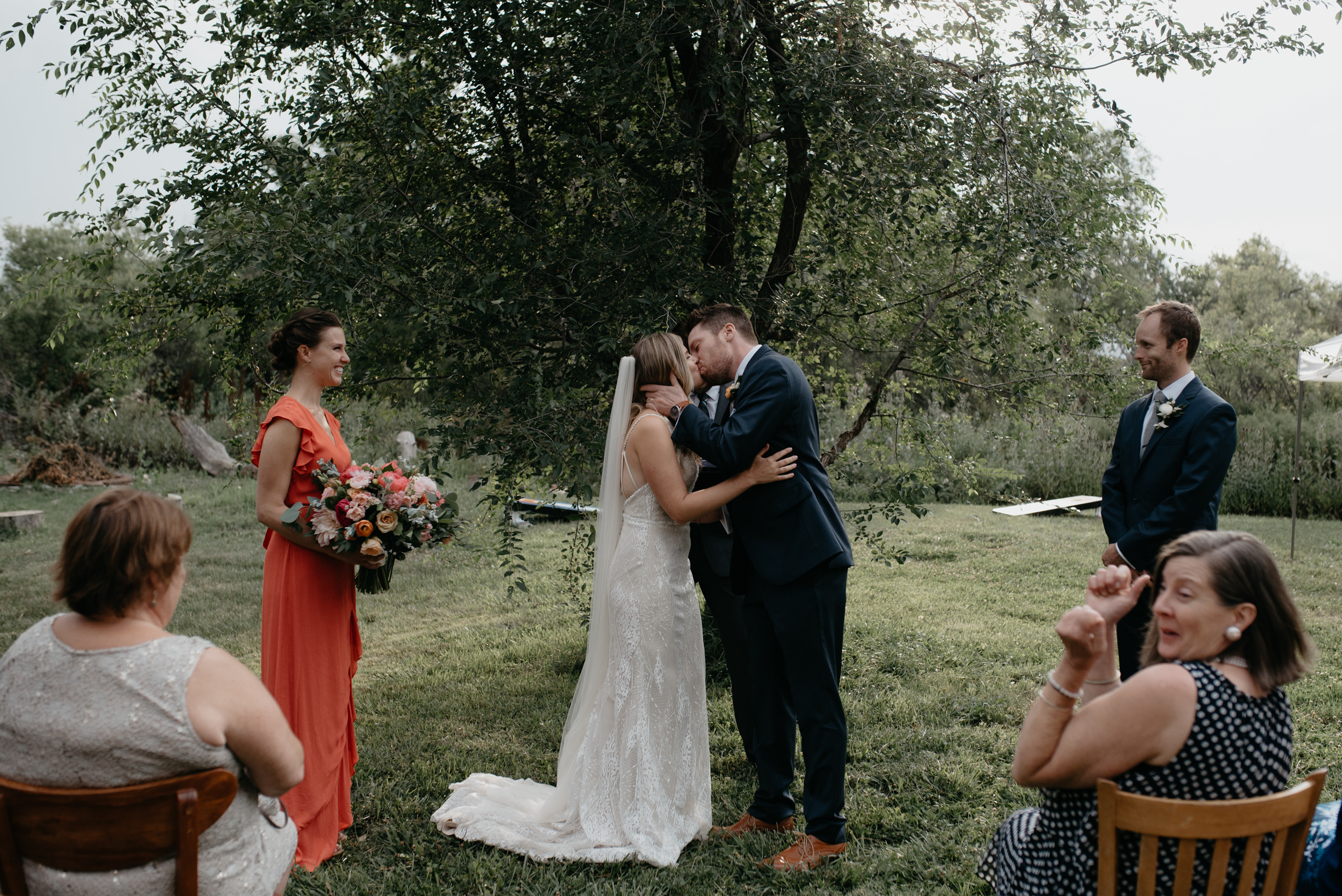 First kiss at Boulder, Colorado intimate wedding ceremony. Boulder, Colorado wedding photographer.
