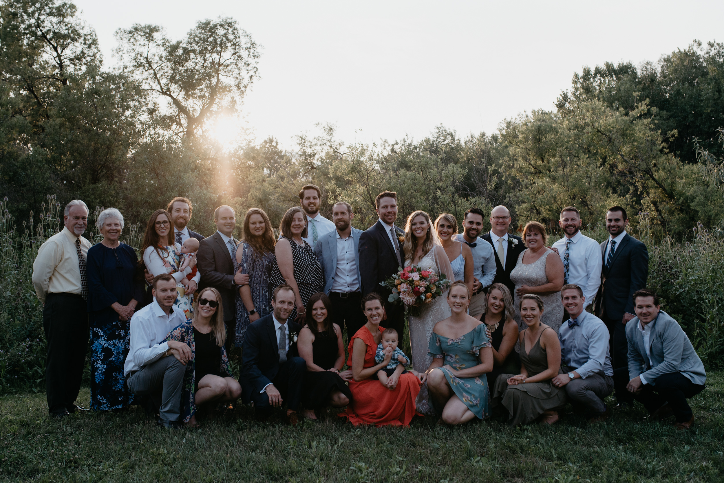 Entire group shot of all guests at wedding. Boulder, Colorado wedding and elopement photographer. Wedding at Three Leaf Farm.