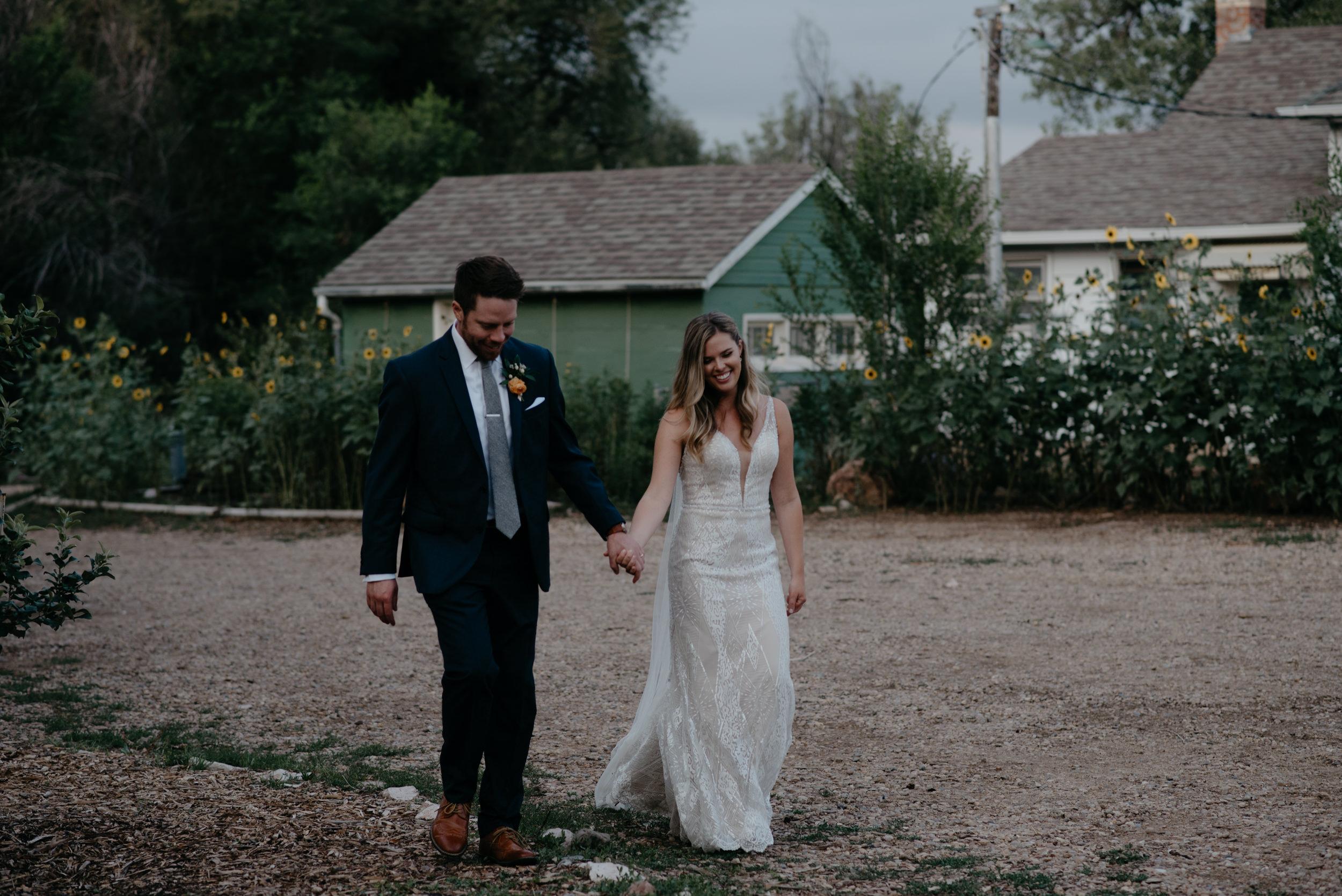 Bride and groom grand entrance. Boulder wedding photographer. Colorado wedding and elopement photographer. Rustic wedding in Boulder at Three Leaf Farm.