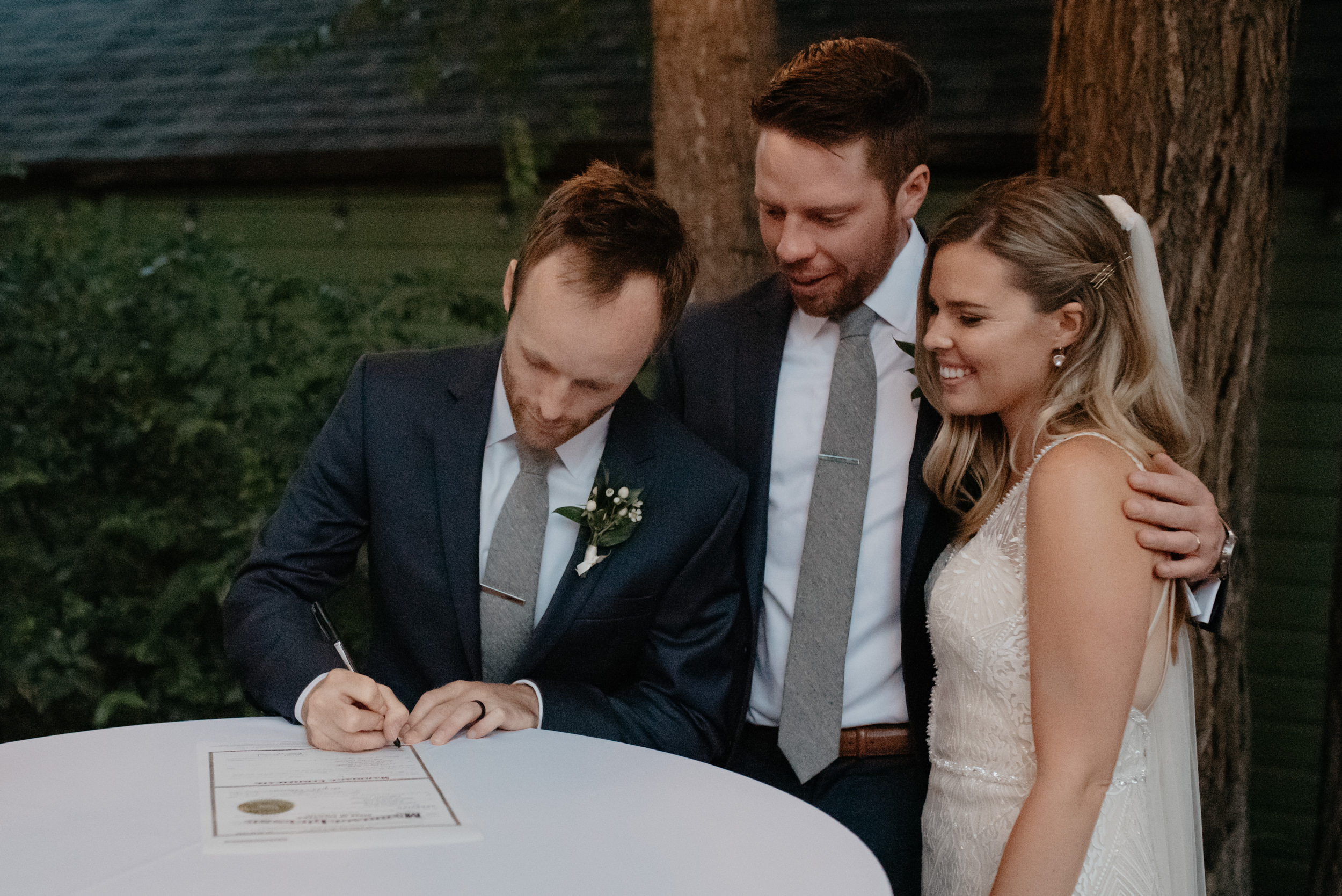 Boulder wedding photographer. Bride and groom signing marriage license. Colorado wedding and elopement photographer.