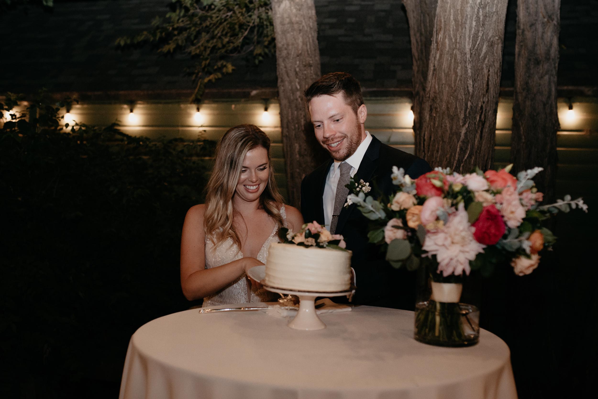 Boulder wedding photos. Bride and groom cutting cake. Denver wedding and elopement photographer.