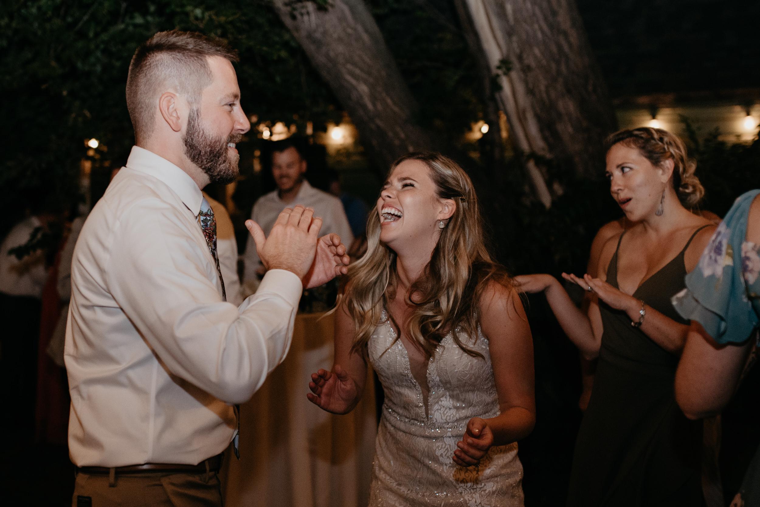 Colorado elopement and wedding photographer. Friends dancing at Boulder wedding reception.