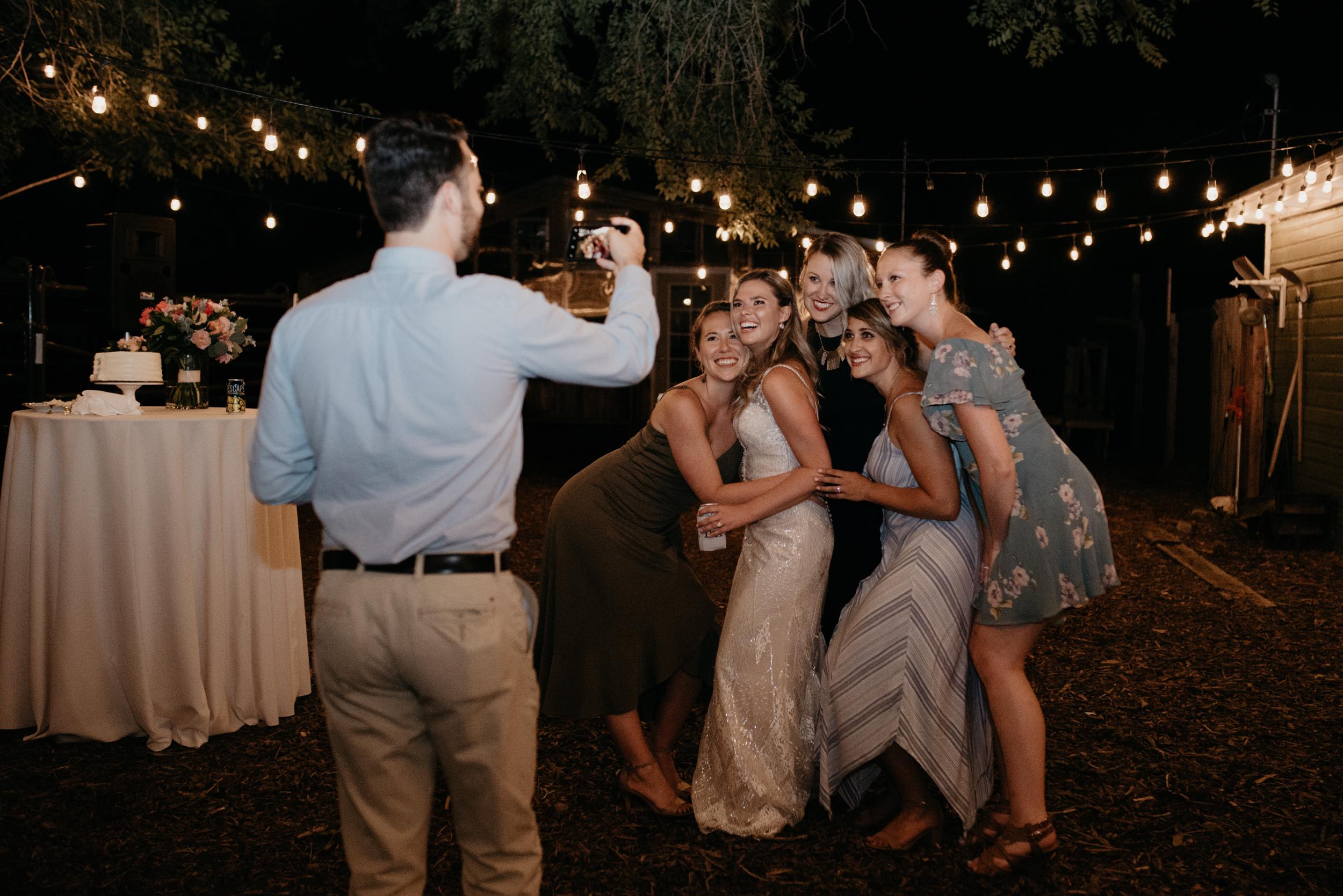 Friends taking photos at Three Leaf Farm wedding. Boulder, Colorado wedding and elopement photographer.