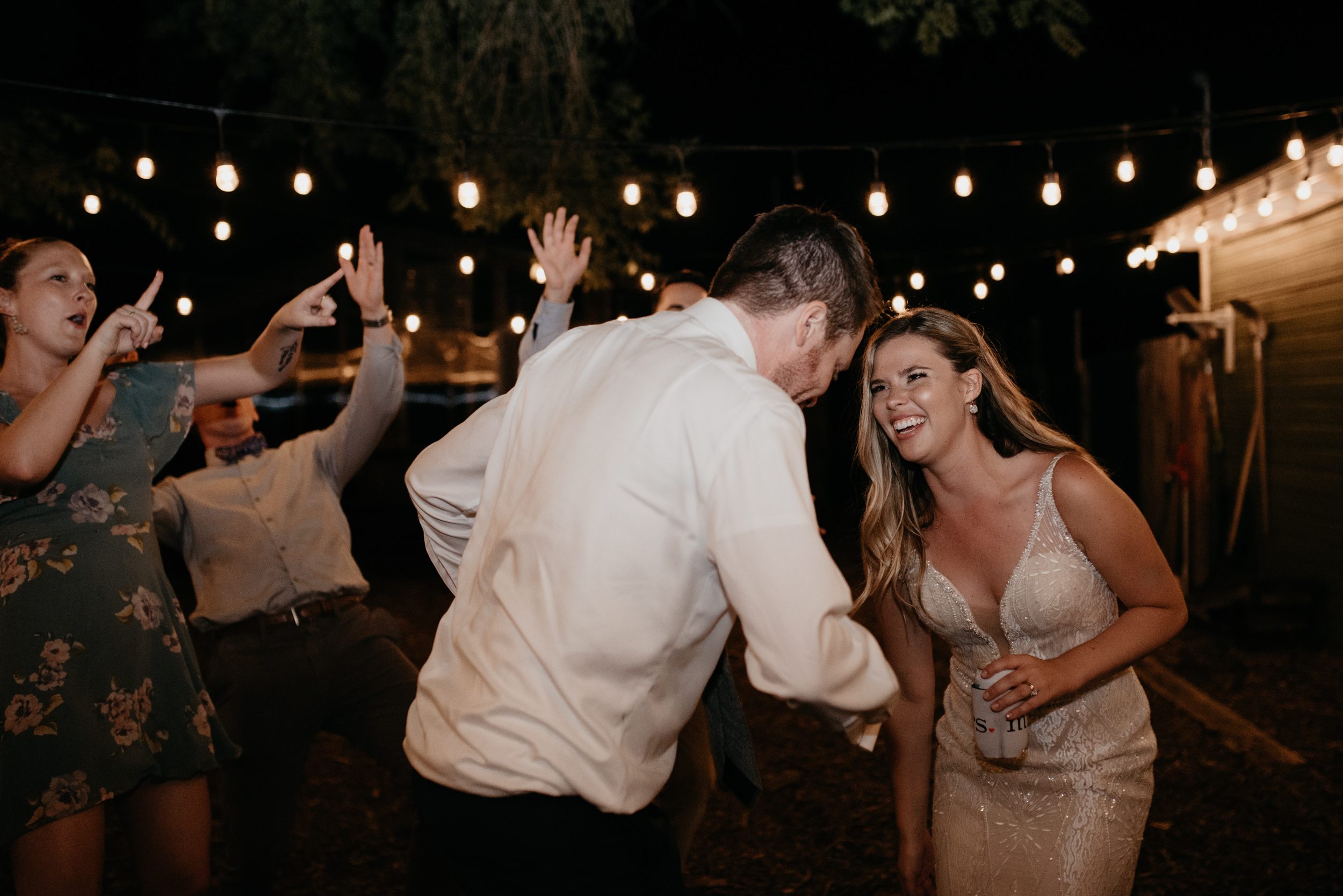 Bride and groom dancing at Boulder, Colorado wedding reception. Boulder wedding and elopement photographer.