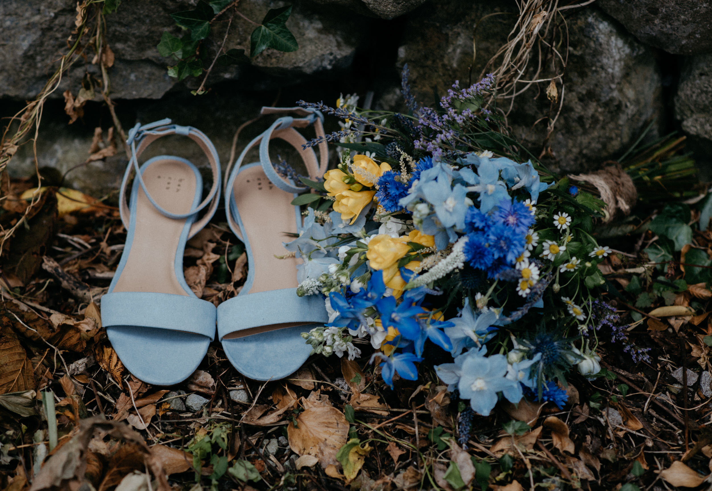 Bride's shoes and bouquet at Ireland destination wedding at Newtown Castle. County Clare, Ireland wedding and elopement photographer.