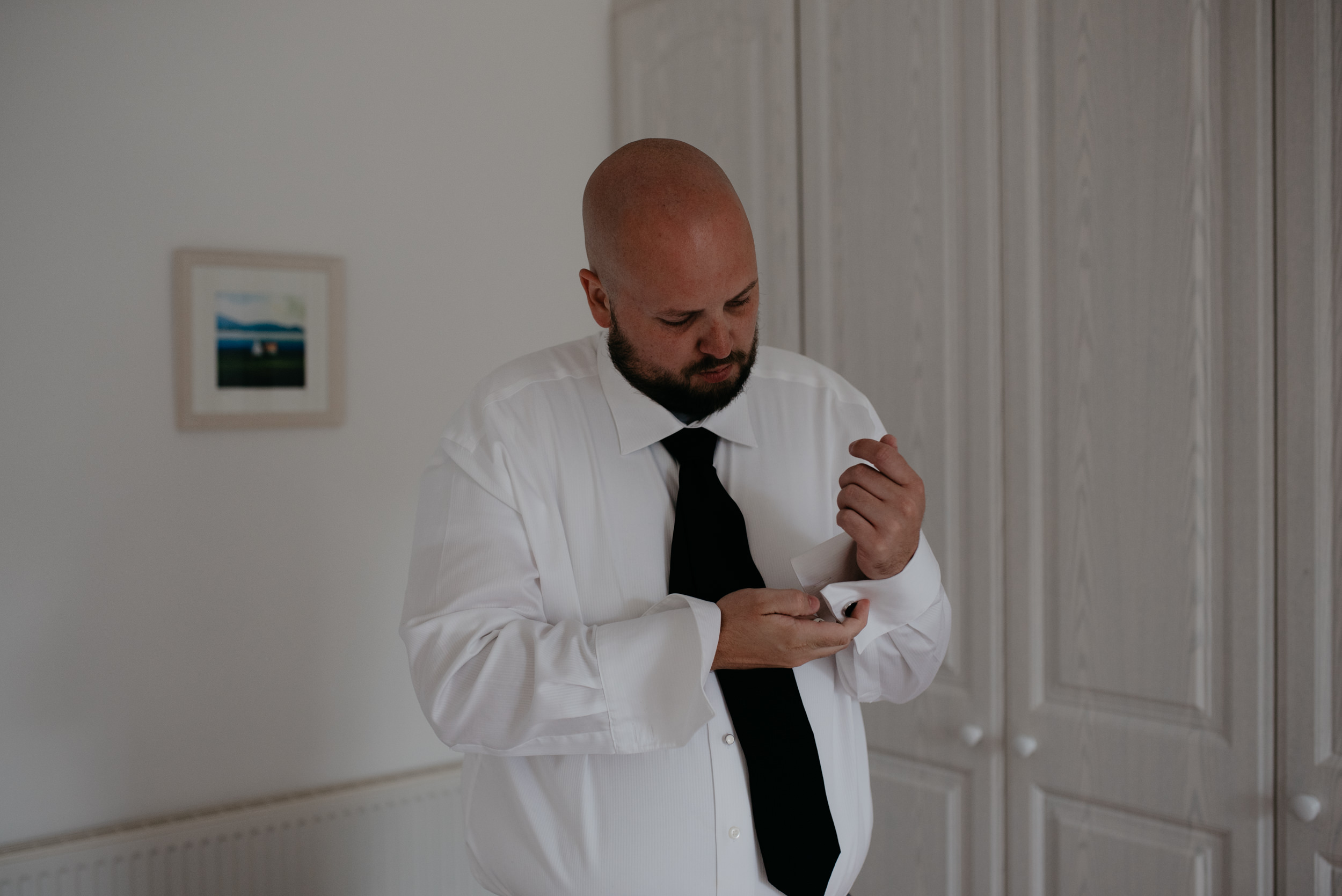 Photos of groom getting ready. Ireland destination wedding at Newtown Castle in County Clare. Ireland wedding and elopement photographer.