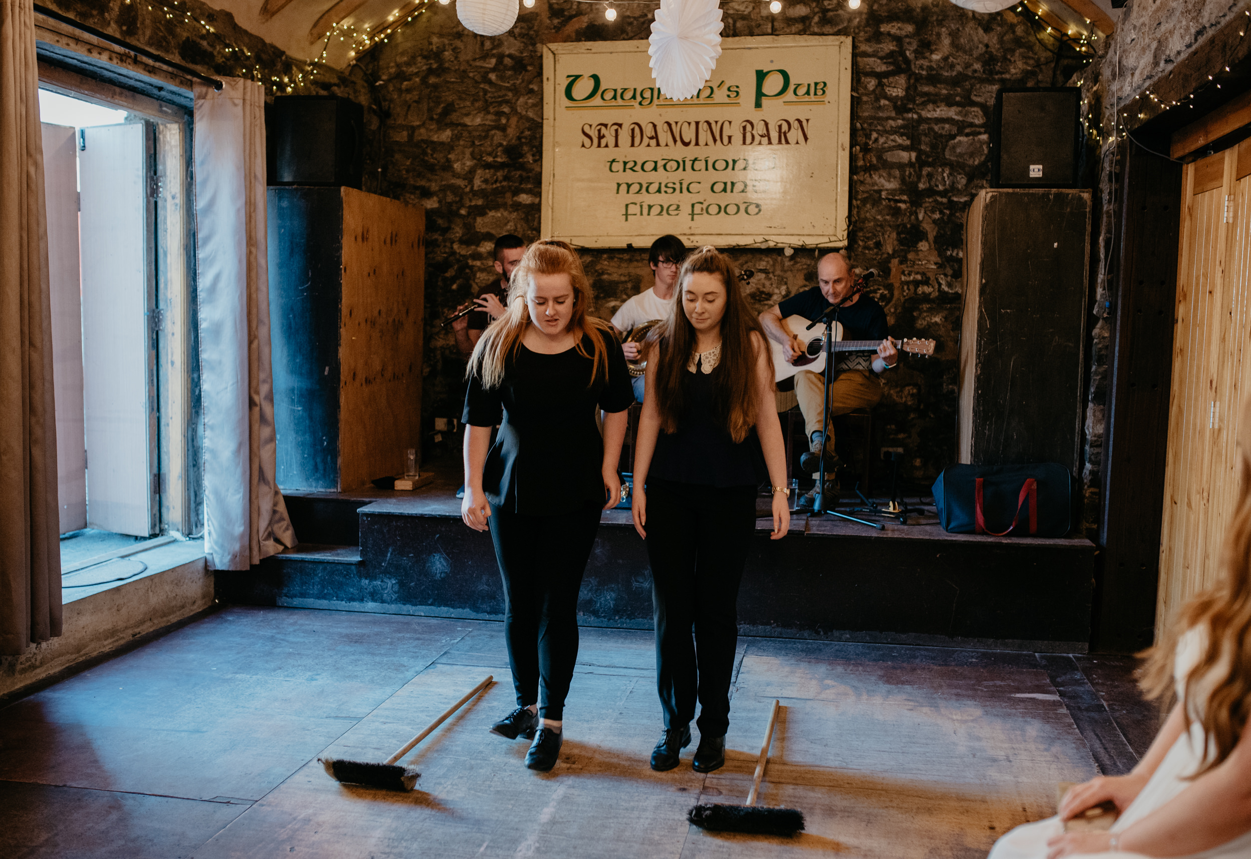 Ireland destination wedding photos. Reception at Vaughan's Pub in Kilfenora, Ireland. Newtown Castle wedding. County Clare wedding and elopement photographer. Cliffs of Moher elopement.