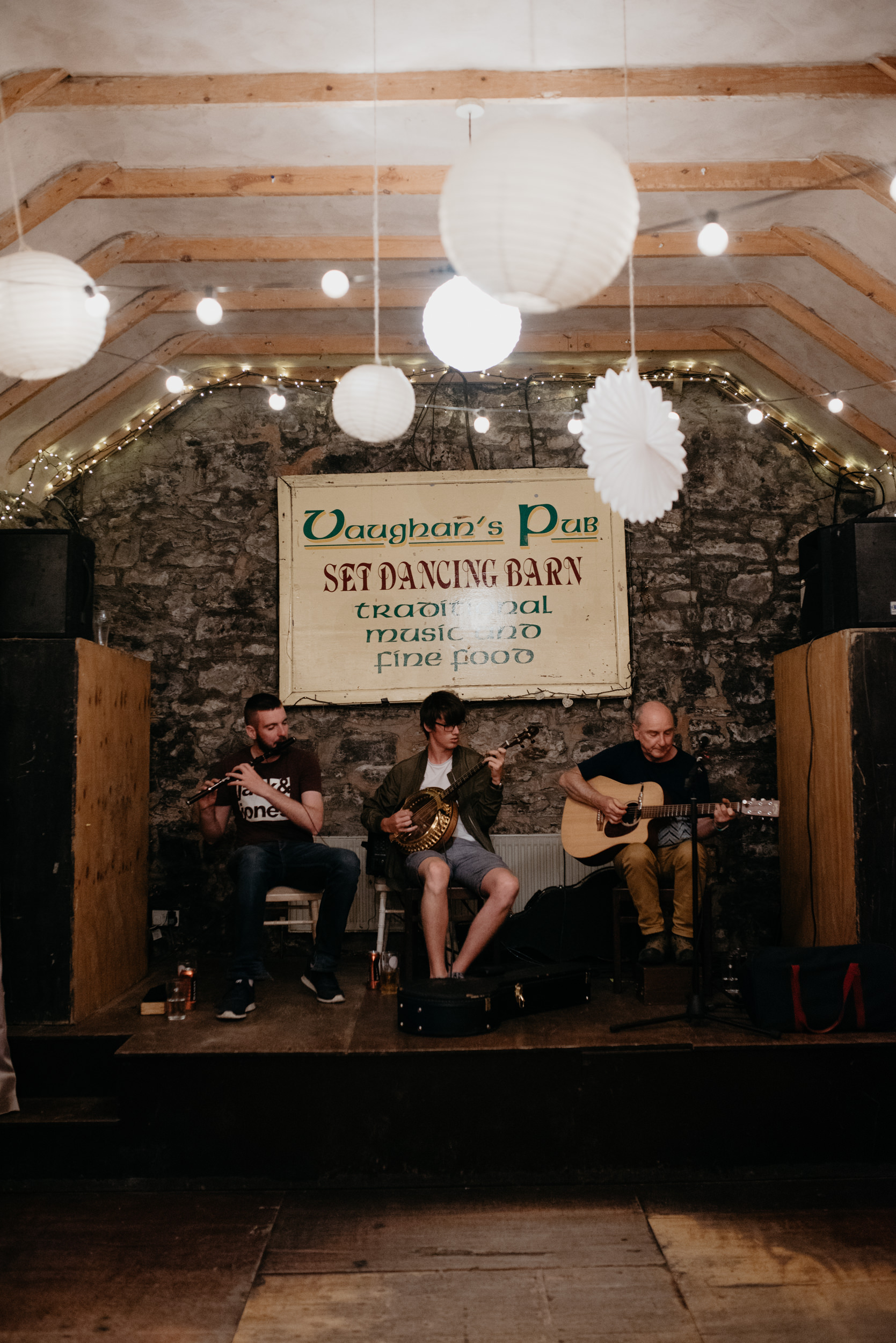 Folk band playing at Vaughan's Pub in Kilfenora for a wedding reception. County Clare, Ireland wedding and elopement photographer.