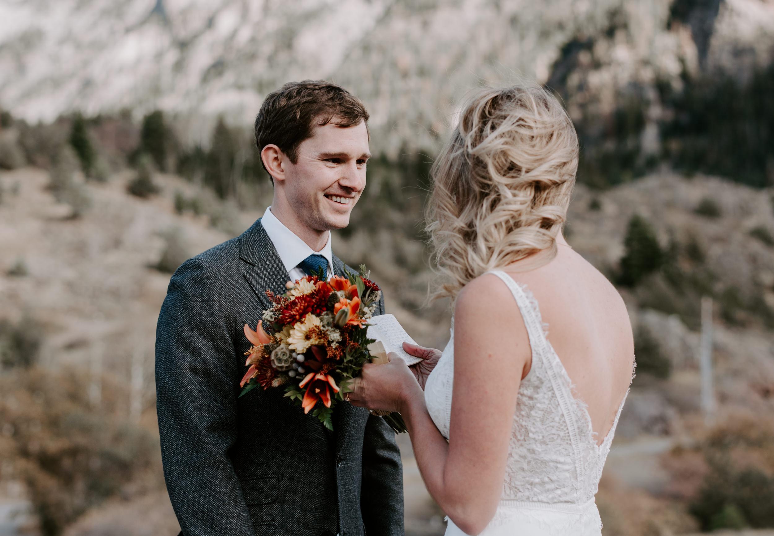 Bride and groom reading vows. Ouray, Colorado elopement ceremony.