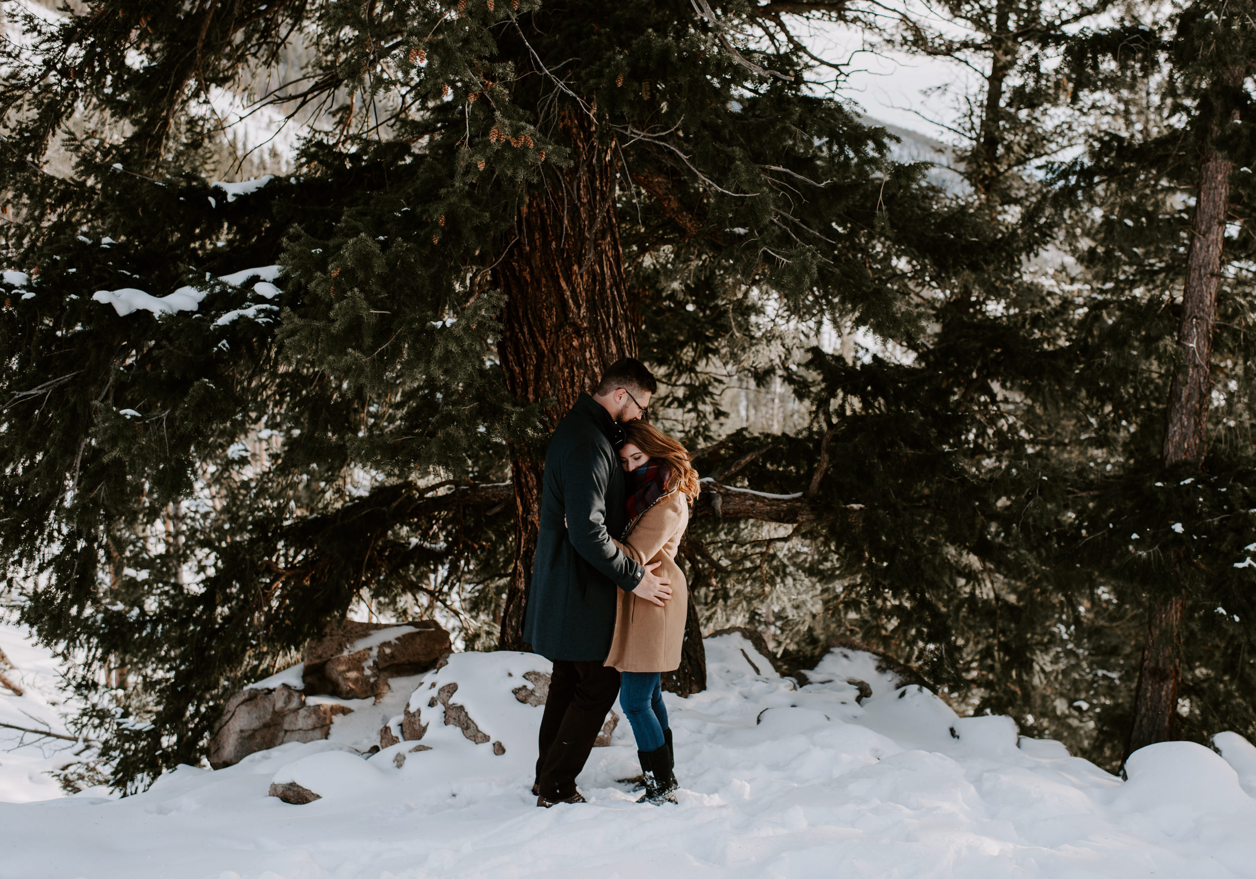 Snowy winter engagement session in Dillon, Colorado at Sapphire Point Overlook.