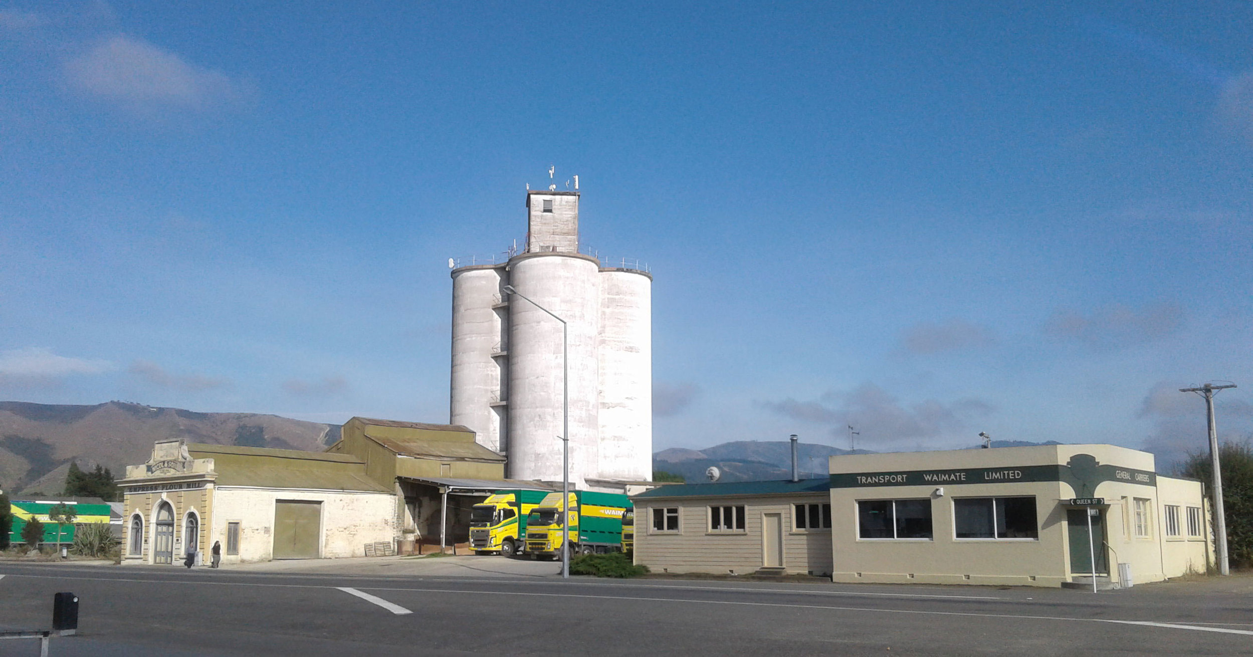 The silos, freshly cleaned and ready for paint, behind the art deco offices of Transport Waimate, Queen Street.