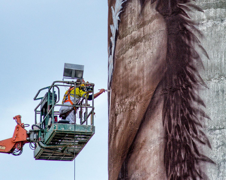 The artist at work. Photo credit Michael Bajko