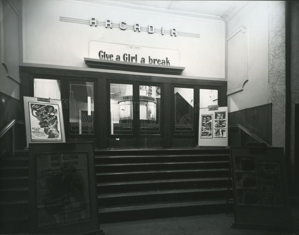 The entrance of the Arcadia Picture Theatre. Advertising the film 'Give a Girl a Break', 1954. Photographer – CE Clarke.Ref #816 Museum & Archives