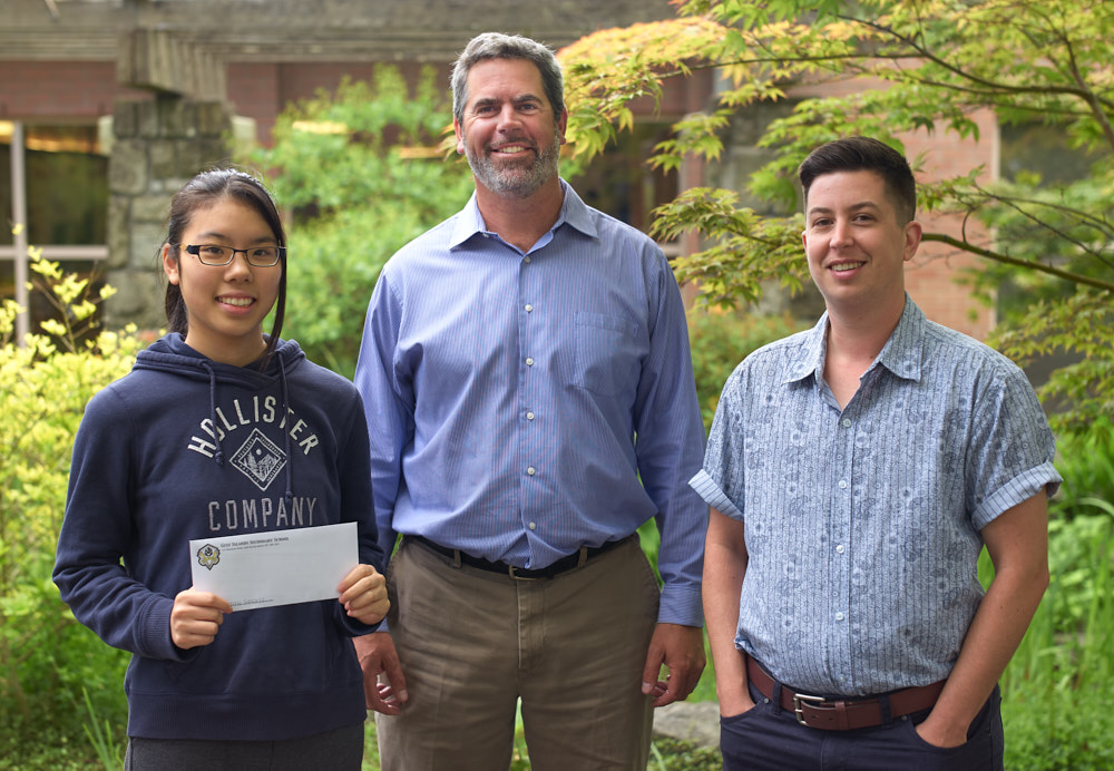 Gulf Islands Secondary School (GISS) student Tamaki Yoshihara (left)displays her 2017 Forum Youth Scholarship. Principal Lyall Ruehlen (middle) and Forum Manager Julian Paquette (right).   Photo by John Cameron